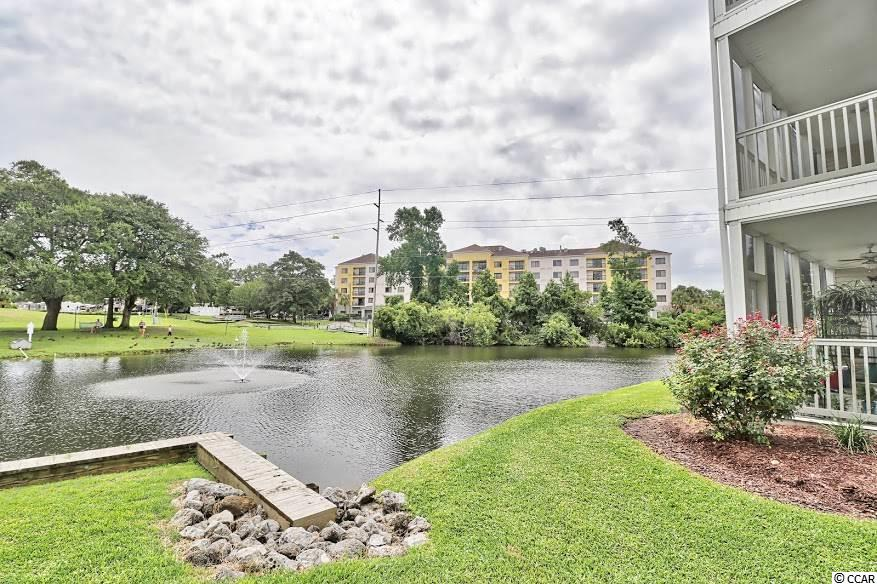 Gorgeous 3BR/2BA Condo located in the very desirable Waterfront @ Briarcliff Commons community on the Intracoastal Waterway. Located within walking distance to Barefoot Landing, close to the areas best restaurants, Myrtle Beach Mall, live theaters including: House of Blues, and Alabama Theater. The Carolina Opry, Pirates of the Caribbean, and many of the areas finest golf courses are just 5 to 10 miles away. This condo features a spacious open floor plan with a huge great room that will accommodate a large family and it has a gorgeous lake view. Awesome kitchen with beautiful granite counter tops and top-of-the-line Stainless Steel Appliances including a glass top range with self cleaning oven, microwave/range hood, dishwasher, and a large french door refrigerator. Gourmet cooks will enjoy preparing meals in this kitchen as it has lots of counter space and tons of beautiful cabinetry. The kitchen is complete with a huge breakfast bar next to the dining area so its perfect for enjoying holiday meals with the entire family as well as entertaining friends and neighbors. Stunning laminate floors were just installed throughout the great room, dining area, and all three bedrooms. All of the interior was recently painted in nice neutral colors so its ready to move into. The master bedroom will easily accommodate a king size bed and it has a large walk-in closet and a large master bath with a double sink vanity, tub and shower. The kitchen, bathrooms, laundry area, hallway and foyer have tile floors for easy maintenance. You'll enjoy relaxing and drinking your morning coffee while you listen to the birds chirp on the huge screen porch which overlooks the gorgeous lake. There is a storage area for your beach chairs, fishing poles, golf clubs, etc on the screen porch.This unit is located on the second floor of Building 2 and it has an elevator. Amenities include a large swimming pool which overlooks the Intracoastal Waterway and a gazebo. The HOA fees cover pest control outside and inside, exterior insurance, water, sewer, trash pick-up and basic cable. Located less than 3 miles to the beach so you can catch a wave or sit back, relax and soak up the sun as often as you wish. Make sure you take in a stroll on the famous boardwalk in the heart of downtown Myrtle Beach where you'll enjoy old fashion ice cream, hamburgers, hot dogs and milk shakes. Square footage is approximate and buyer is responsible for certification.