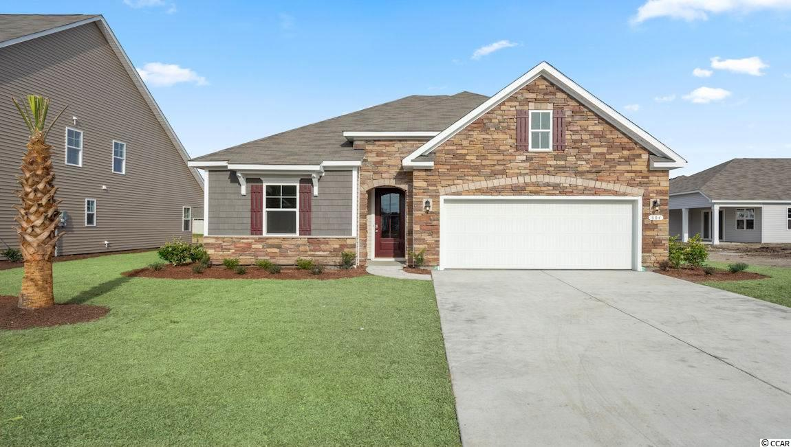This home is located in popular Surfside Beach. This is the Acadia floor-plan, Elevation D with a beautiful stone front. Photos and Virtual tour are of a similar home.
