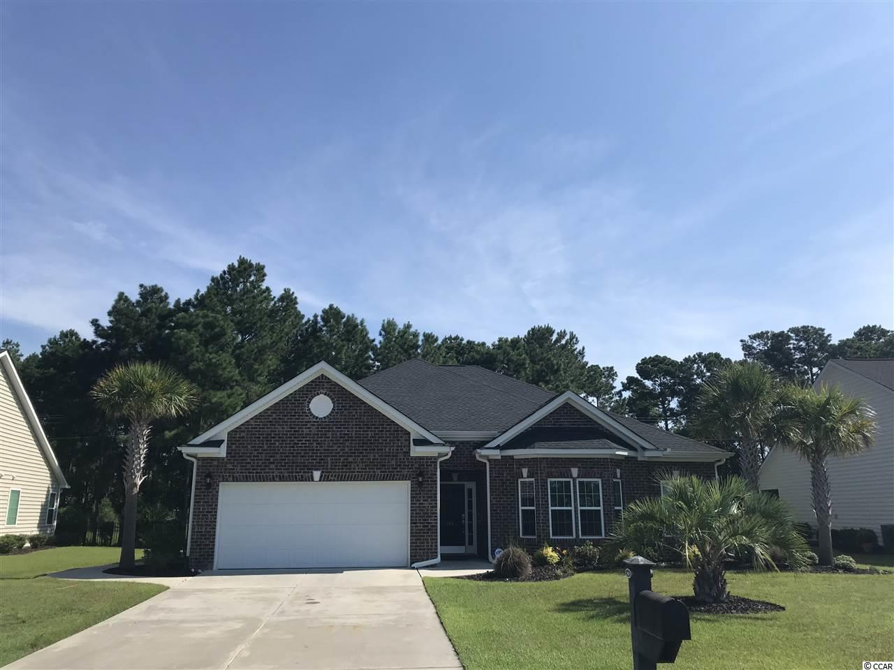 """LOOK NO FURTHER! This is the home you have been looking for! Welcome to Brookefield Estates, a natural gas community, and the extremely popular Magnolia model! This amazing 3bed/2.5bath has been extremely well cared for and it will show as soon as you walk through the door. This has been a 2nd home and can be completely turn key as ALL appliances are included and the furniture is negotiable. 144 Shenandoah sits on an oversized lot complete with irrigation, palm trees and mature landscaping including beautiful Canna plants surrounding the patio. This home has a natural flow starting in the foyer with decorative inlays and then moves forward into the great room. Gorgeous hardwood flows through all living areas with carpet in the bedrooms. To the right of the foyer is the formal dining room complete with wainscoting and a large bay window allowing for ample natural light. The open concept kitchen neighbors the dining room and is equipped with a work island, upgraded 42"""" cabinets (which all include roll trays for easy storage), granite countertops, a HUGE walk in pantry, work desk, SS appliances, and breakfast nook. The middle of the home contains the great room with recessed lighting, perfect for entertaining or relaxing on those quiet nights. This home features a split bedroom plan allowing for plenty of privacy in the master suite. The master suite comes with separate """"his"""" and """"hers"""" closets, separate """"his"""" and """"hers"""" vanities, walk-in shower, and garden tub. Towards the rear of the home you will find the oversized Carolina room with the rear wall full of windows. The screened porch sits off the back of the home and of course this home backs up to woods to allow for 100% privacy. 144 Shenandoah is just minutes away from everything Murrells Inlet and Myrtle Beach have to offer, yet is tucked into the quiet neighborhood of Brookefield Estates, complete with a community pool and play area. Put this home on your short list of homes to see as it's sure not to last long!"""
