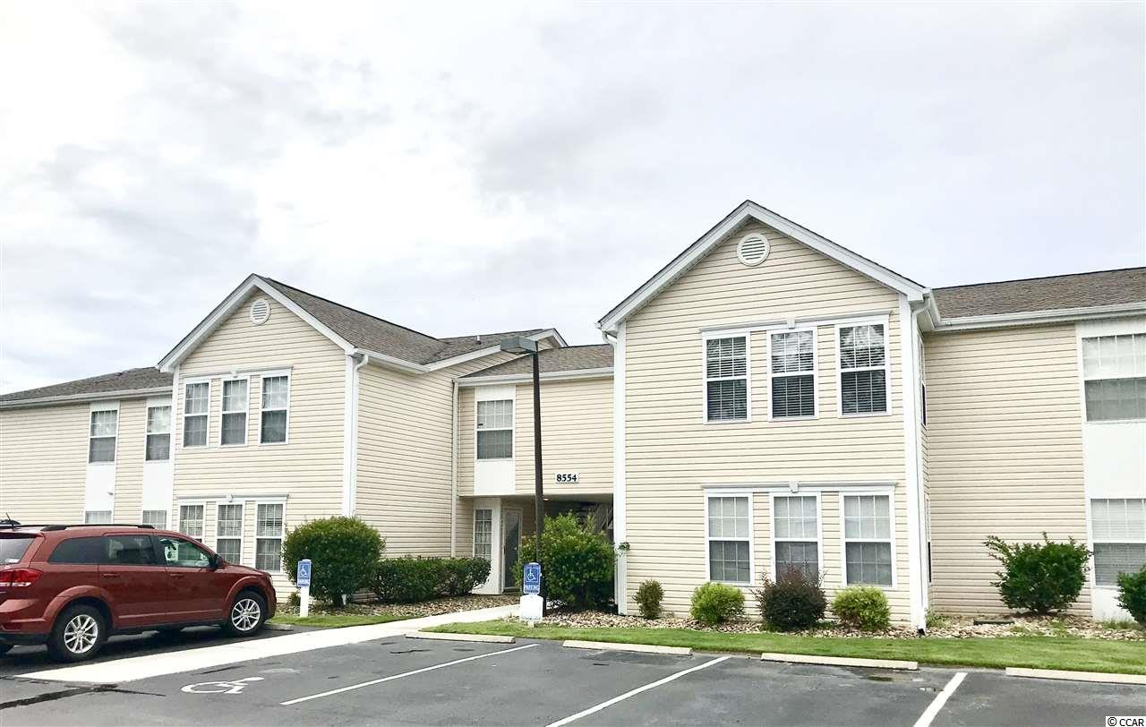 **Motivated Seller** Amazing value in this move in ready, 3 bedroom, 2 bathroom condo located 2 miles from the beach! You'll love the fresh look and feel of the open floor plan with vaulted ceilings. Great storage features include a spacious master bedroom with 2 closets, a laundry room, coat closet by the foyer, and even the Carolina room has a walk-in closet! Relax in your sunlit filled Carolina room right off the living room or take a dip in the community pool. Floor plan makes it feel much bigger than 1275 heated sq. ft. Only 12 buildings in this small, quiet complex. Wonderful location close to shopping, dining, beach and quick access to Hwy 17 bypass. Ready for immediate occupancy!