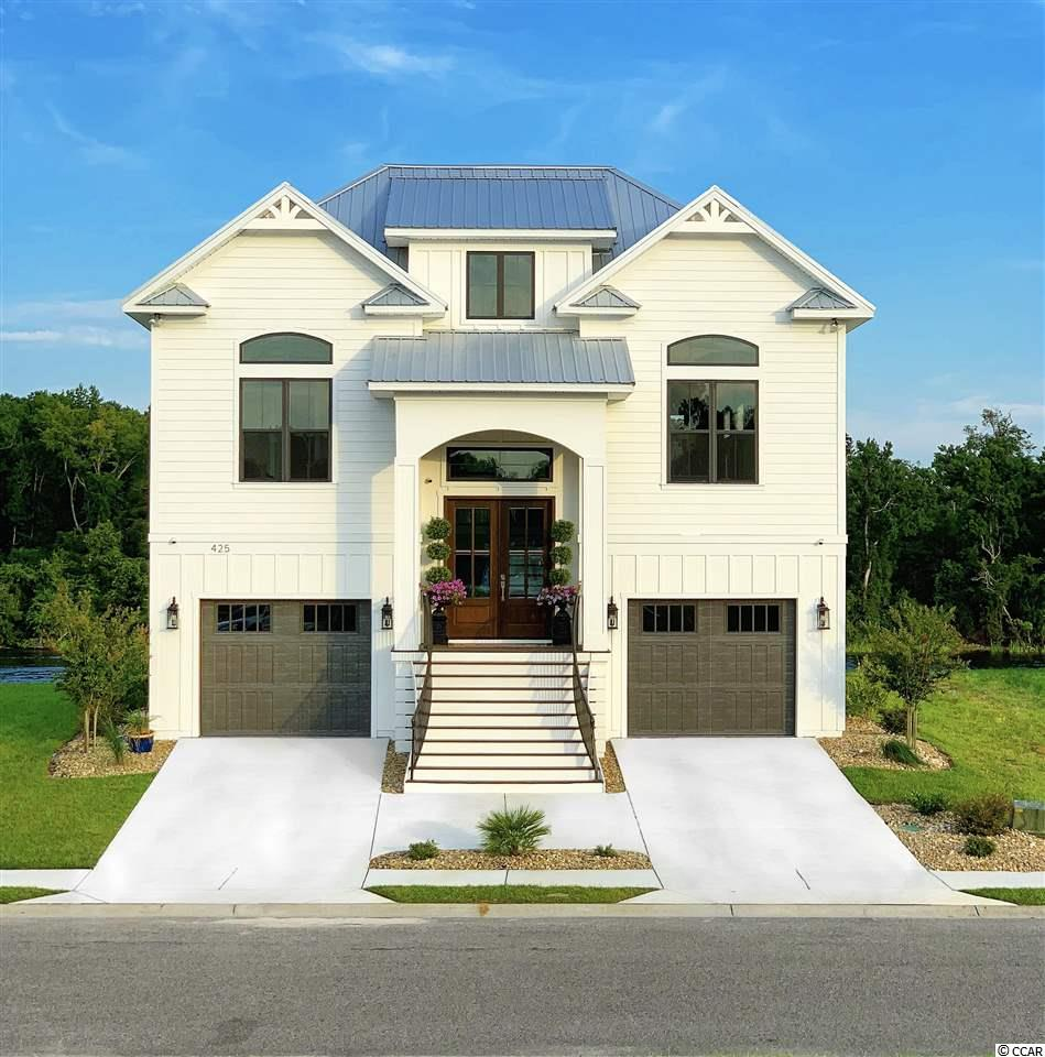 Beautiful custom home on the Intracoastal Waterway in the gated community of Boardwalk on the Waterway. Custom kitchen with granite counters and professional grade appliances.  All the wet areas are tiled and all the bathrooms have tiled showers.  The ground floor features a game room that leads to the outdoor entertainment area. The outside features a natural gas an outdoor kitchen.The main floor has 13ft ceilings with floor to ceiling windows. All interior and exterior doors are 8ft tall.  The house has 1200 square feet of covered porches with pine ceilings overlooking the waterway.  The house has a elevator shaft with an option to have it installed.  The community also has private boat storage, 5 day docks, boat launch, security and a 2500ft boardwalk along the Intracoastal Waterway. Floating dock and 16,000lb boat lift already in place.