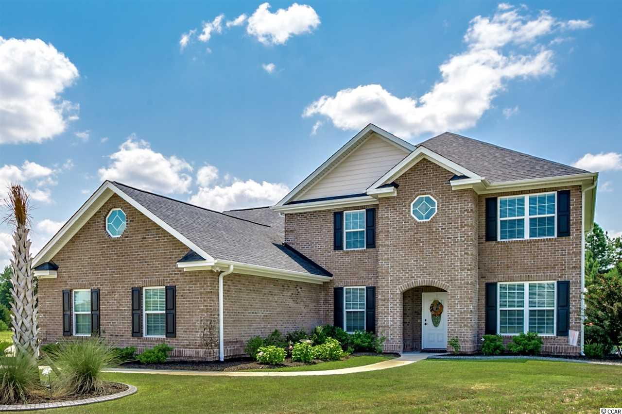 A must see custom built brick waterfront home situated on a .58 acre cul-de-sac lot in the desirable Wild Wing Plantation golf community. This beautiful home offers many sought after features including cherry Forever Mark cabinets with soft close and granite counter tops through out. The kitchen has stainless steel appliances and is open to a cozy living room with a gas fireplace and custom built- ins. The large owners suite has a double tray ceiling with ambient lighting, 2 walk-in closets and a master bath that features double sinks and a large walk- in ceramic tile shower with dual shower heads. A separate dining area with ambient lighting in the tray ceiling, a study, laundry room and half bath finish out the first floor. Upstairs you will find a loft area, 3 additional bedrooms, two bathrooms, one of which is a jack-n-jill, and a nice sized bonus room with a large walk in closet that can also be used as a second master bedroom. Furnishings negotiable. Outside you have a screened in patio, fenced rear yard with 2 gates, an irrigation system with a separate water meter and gas hook up for outside grilling. Beautiful curb scaping finishes out the home appeal. The community offers a club house, weight room, pickleball/tennis courts, along with swimming pools, hot tub, slide and splash zone for the little ones. All this is located close to shopping, airport, hospital and everything that Myrtle Beach has to offer.