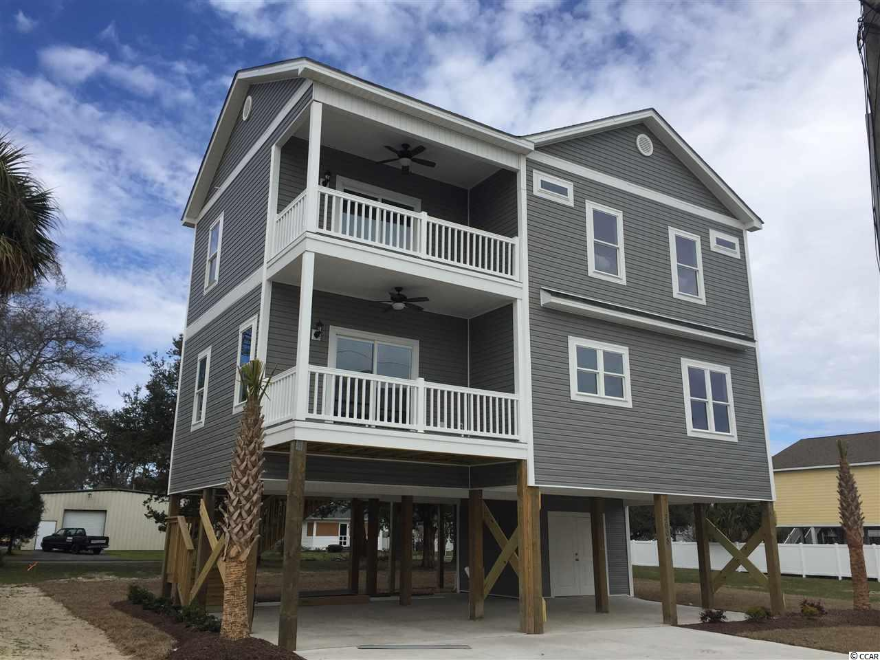 TAKE ADVANTAGE OF THIS RARE OPPORTUNITY OF BEING ABLE TO BUY A NEW CONSTRUCTION HOME WITH A OCEAN VIEW IN THE DESIRABLE WINDY HILL SECTION OF NORTH MYRTLE BEACH. ONE BLOCK OFF OF THE OCEAN, SHORT WALK TO RESTURANT AND CONVENIENCE STORE. GOLF CART RIDE AWAY FROM SHOPPING, RESTURANTS AND ENTERTAINMENT AT BAREFOOT LANDING.