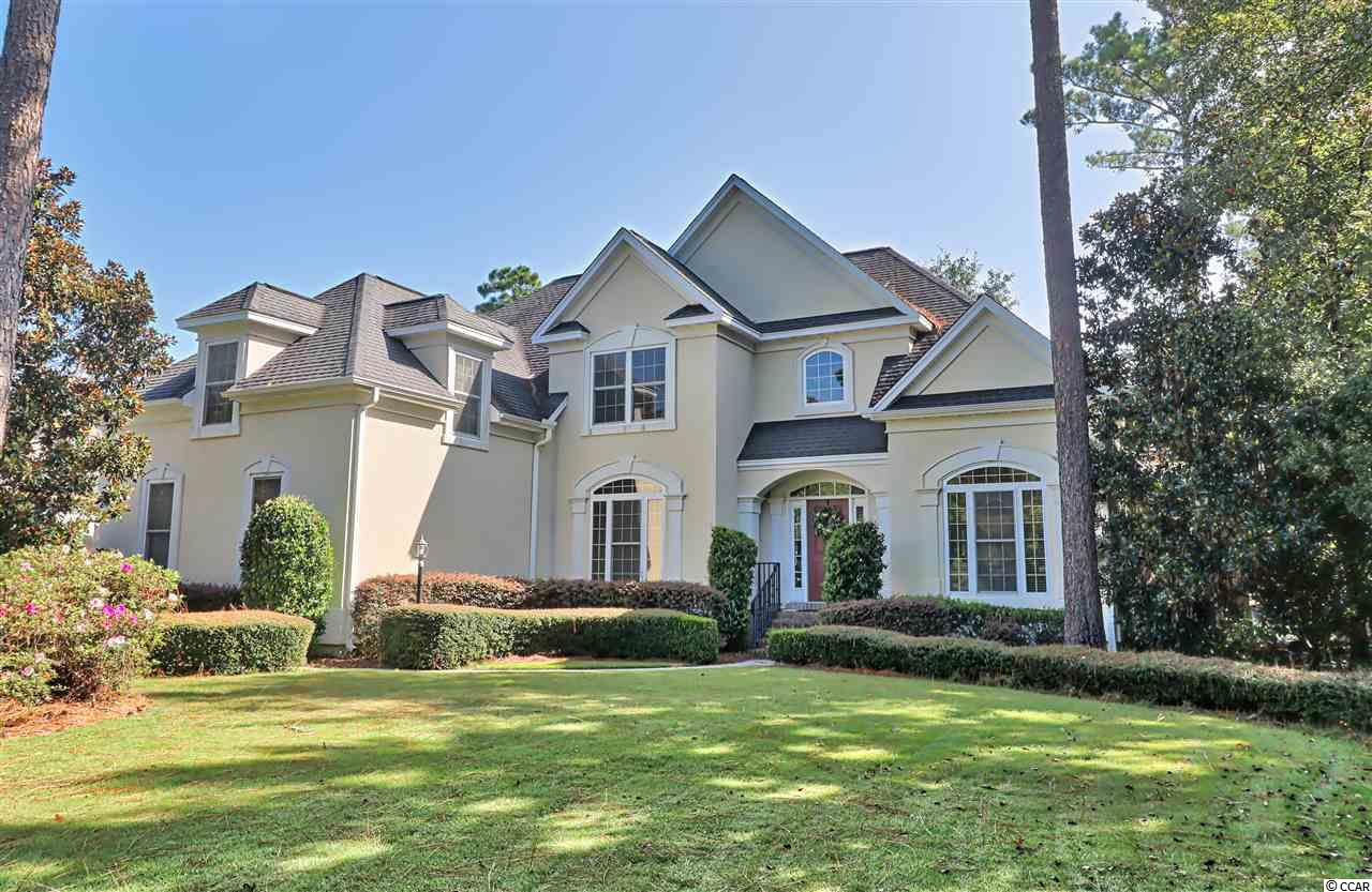 """Location and a golf course view - what more could you ask for. This custom built home was the first to be built in the gated community of Highwood in Prince Creek and is located on the Tournament Players Club 5th tee, par 3. TPC course is one of only three five-star courses in the Carolinas. The open and bright floor plan makes this an ideal home for entertaining family and friends. This 4-bedroom, 3 bath offers a formal dining area and office, great room with vaulted ceilings and gas fireplace for cozy evenings. The custom eat-in kitchen with a large island and granite counters, features plenty of cabinets for storage. Walk upstairs to a spacious media room - complete with wet bar and fridge, not to mention spectacular views of the golf course. The recreation/workout room can be another bedroom. Hardwood floors in dining, great-room, downstairs offices and sitting room. The home was custom-built and designed with particular attention to detail in every room. The back deck is perfect for relaxing and viewing the golf course. Highwood community offers a pool, clubhouse and lighted tennis courts, with walking paths, natural areas and additional green space. The community is one of the most impressive of the Prince Creek communities. TPC memberships available (not a requirement).  Enjoy all that Murrells Inlet has to offer at the """"Seafood Capital of South Carolina Marsh Walk"""". Myrtle Beach is only a 15-20 minute drive North and Charleston a 60-90 minute drive South. This is a dream home. Stop by; you won't be disappointed."""