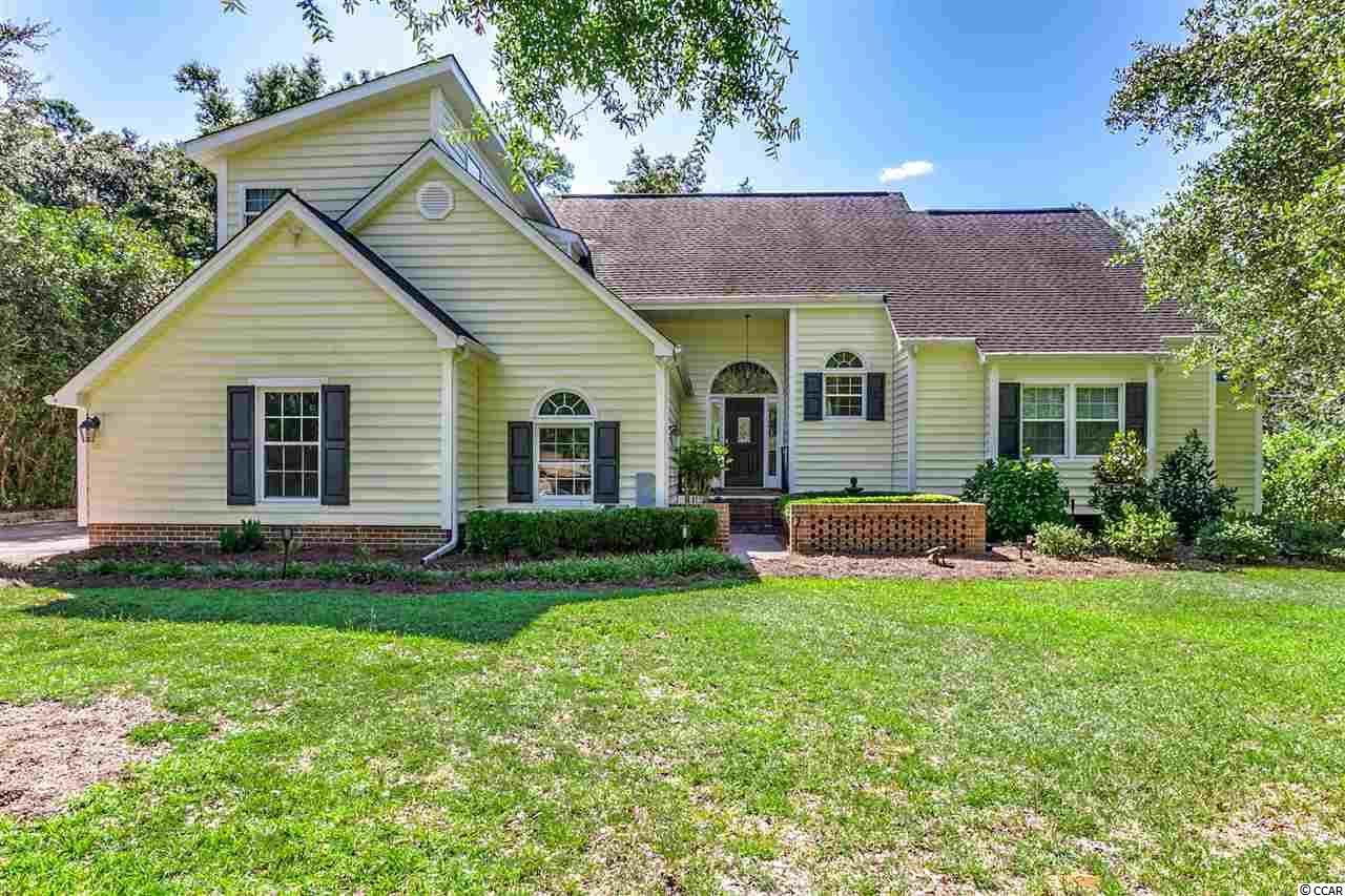 This 4 bedroom 2 and a half bath property is nestled in the low country region of Pawleys Island in Litchfield Country Club. Here is a home with all the updates! When you turn onto the property, you will note that there is a grade to the driveway indicating that this lot is higher than much of the rest. Once you have entered the property, you are greeted with streaming natural light that fills the vaulted, open living space. From there the living area opens into the formal dining room. The kitchen and separate den/sun room are located off of the dining area. The kitchen has been updated with granite countertops, stainless steel appliances, and white cabinets. The kitchen also features smart lighting through Google home. The spacious master suite is located on the first floor of the home for one level living. The master bathroom has an updated tile shower, double sinks, granite countertops, and a soaking tub. An office, study, nursery or sitting room is located off of the master bathroom for the owners' convenience. The upstairs includes 3 bedrooms, each with abundant storage space. Of those 3 bedrooms, one is a new addition added very recently by the current owner. This room has been thoughtfully designed to include a vaulted ceiling with extra windows to let in the sunlight and dual closets. The upstairs space also features a loft area ideal for a TV room or play area. Wait until you see the outdoor space! The home features a sizeable screened-in porch complete with a hot tub perfect for those fall and winter nights! The backyard has considerable space giving you the opportunity for many activities. The Litchfield Country Club Community does not have a mandatory HOA which allows you to keep your boat, RV, or trailer on your property at all times. Make sure to put this on your list to view with your Realtor today!