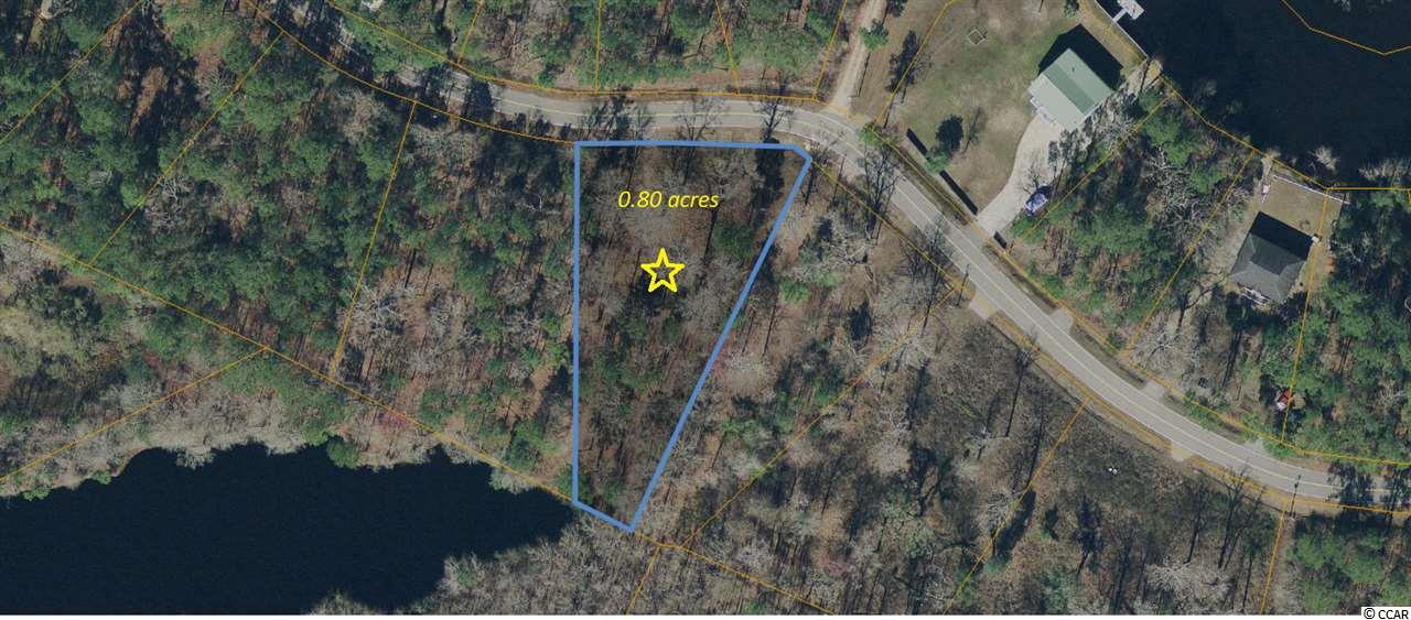 Beautiful home site near the Waccamaw River! Don't miss this opportunity to buy a secluded lot to build your dream home!  Enjoy the peace and quiet of the country but still be close to downtown Conway and Myrtle Beach. Come view this gorgeous lot today!  Public water and sewer is available.  Plenty of room for your boat and RV.  An easement allowing Riverfront access has been granted for this lot.  Public boat landing less than 1 mile from lot.