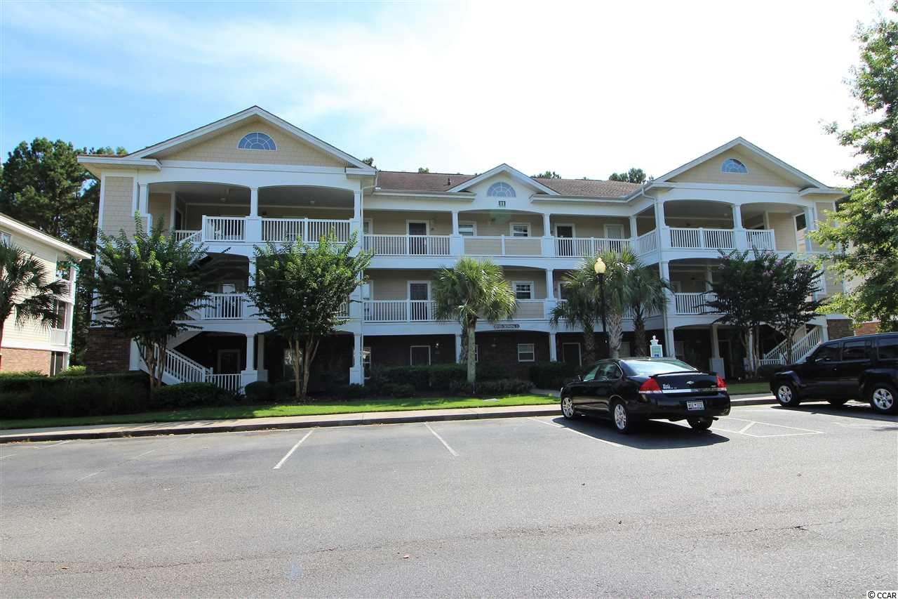 You will love this top floor end unit located in the River Xing subdivision within prestigious Barefoot Resort. It is truly exceptional with Cathedral Ceilings in the living and dining area and Tray Ceiling in the master Bedroom with crown moldings in both. Best of all the unit comes fully furnished and offers a premium location with views of nature and golf course plus easy access to pool area, barbecue and mail service. The building is located just steps to the shuttle stop that takes one back and forth to the Barefoot Resort Beach Cabana offering private access and parking to all owners. There is also a 15,000 square foot waterway swimming pool that can be used. Barefoot Resort also has 4 championship golf courses, and a marina. The HOA dues are very reasonable considering they cover the following: Insurance on the building, basic cable, wireless internet, maintenance, landscaping, water and sewerage. No other resort offers so much. Great unit! Great Location! Great Price!