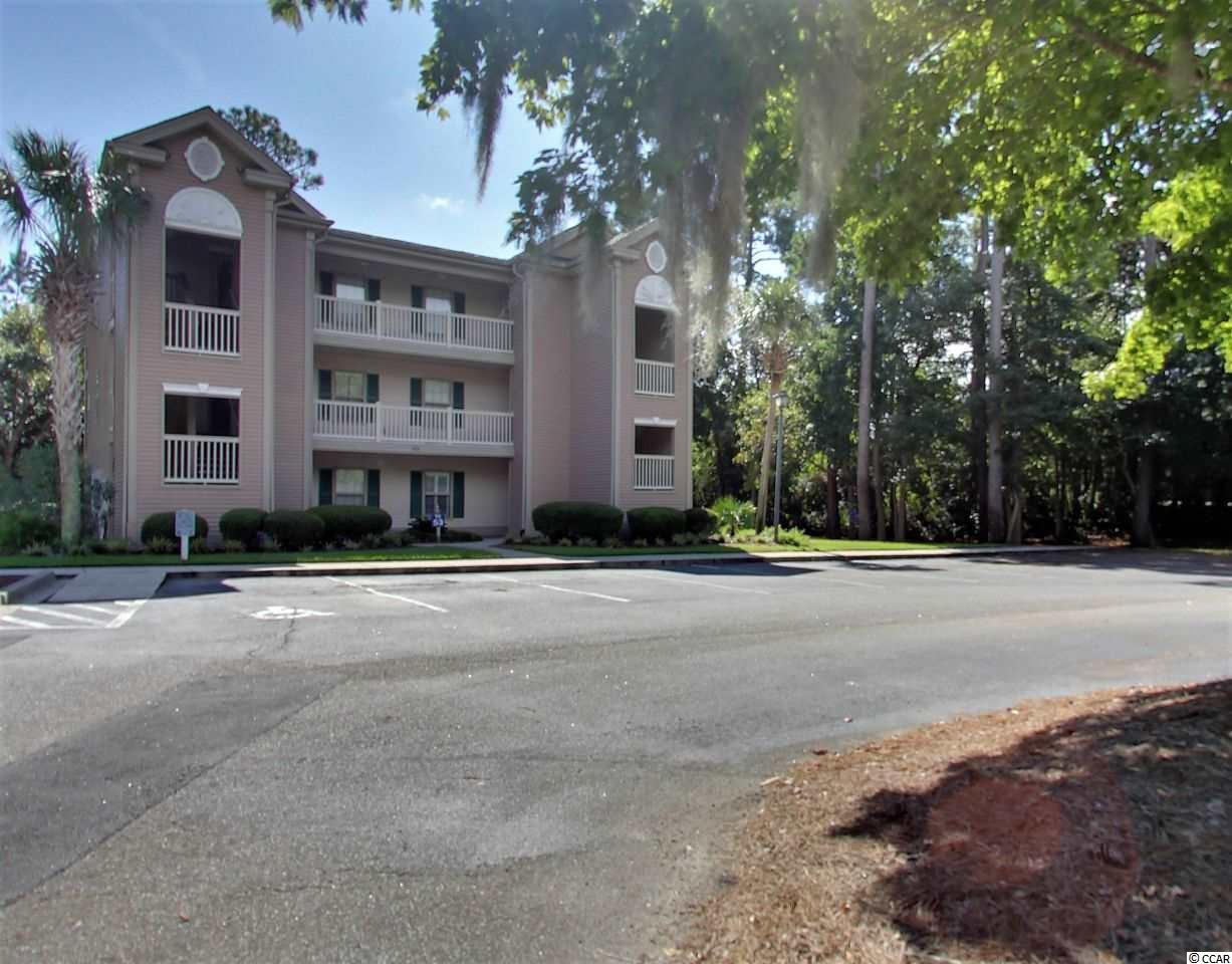 You will be hard pressed to find a 2nd floor furnished, 2 bedroom, 2 bath, end unit in True Blue 1 with as many high end upgrades as this unit features. Great screen porch with filtered views of the True Blue golf beyond. Plenty of parking in front of this well located building within the desirable True Blue Plantation. This condo features brand new luxury vinyl plank flooring in the main living area. TRANE HVAC system installed in 2016. Top of the line, and built to last. The sellers have agreed to install brand new stainless appliances in the kitchen too. A new garbage disposal has just been installed. New ceiling fans installed in all rooms. New white wood blinds installed in the living room. Sold completely furnished with 3 flat screen TVs!! Just bring your toothbrush and move right in! Golf, tennis, great community pools are just some of the amenities found in True Blue. This has never been a rental, but it is available for both long and short term rentals. The condo is priced to sell quickly. Do not hesitate on this one!