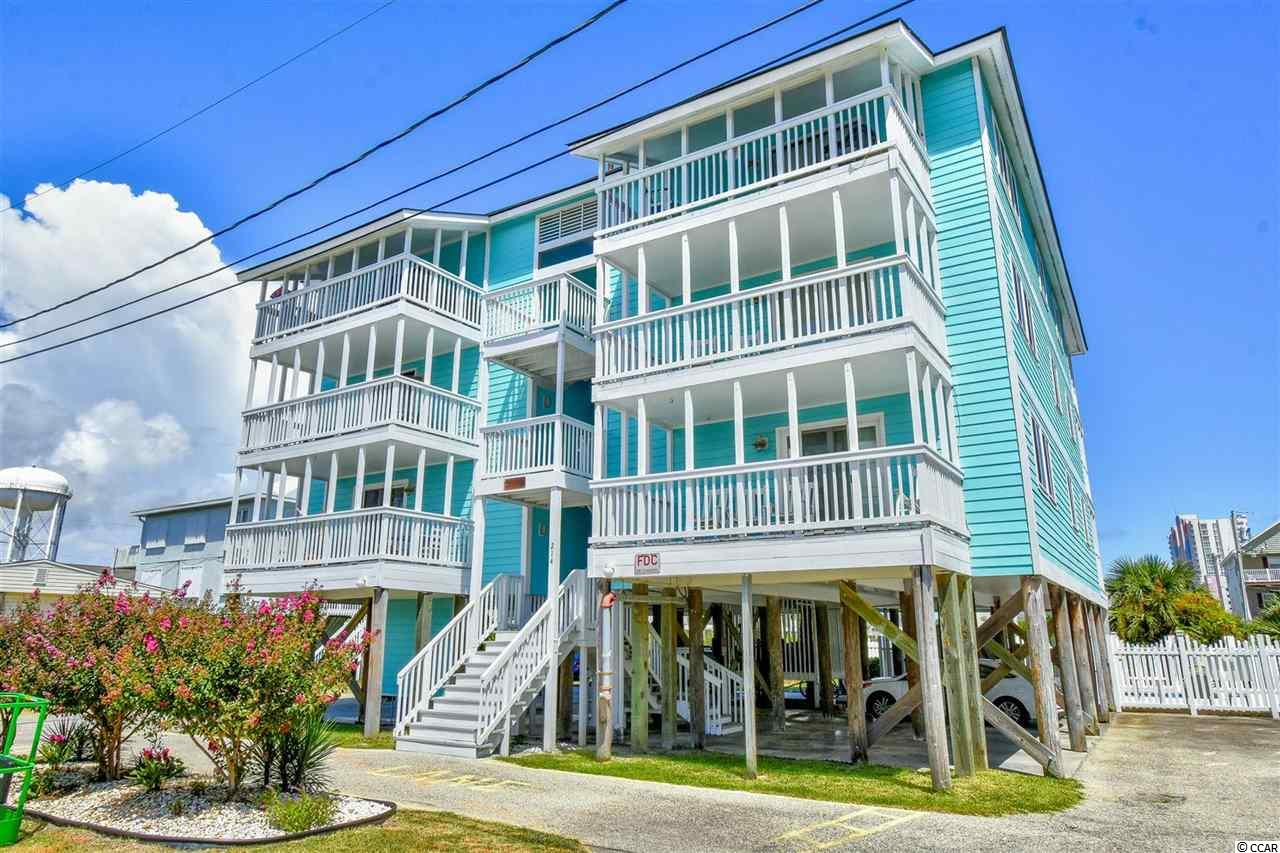 Your own Oceanview slice of Heaven in beautiful Cherry Grove Beach! This cozy, fully furnished 2 bedroom, 2 bath condo is just steps away from the Atlantic Ocean, and sits right on the Intracoastal Waterway marshes at Cherry Grove Beach. Just a short five block walk from the iconic Cherry Grove Pier. The building recently received updates, including a new roof and exterior, and a resurfaced pool deck with new fencing around the outdoor pool. The unit also has new tile floors, vanities, lighting, and fixtures in the bathrooms just last year. Sit and sunbath or splash by the pool or on the beach during the days, and have cookouts at the built in BBQ grill and picnic area in the back yard. The front and back decks are ideal for enjoying stunning South Carolina sunrises and sunsets with your morning coffee or evening cocktail. Close to dining, shopping, attractions, and all of the other wonderful things the Myrtle Beach area is known for, but outside of the busy hustle and bustle of the center of the city, Cherry Grove is truly the gem of the Grand Strand. Don't let this property pass you by. Schedule your showing today.