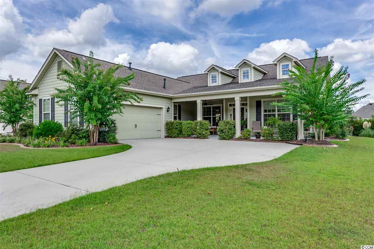 IMMACULATE 3bd/2.5ba, single-story home ON THE WATER in the prestigious, Gated, Natural Gas community of Sago Plantation, just 6 miles to the Beach! Hardi-plank siding, side-load 2-car garage and large front patio greet you as you enter.  Enjoy the backyard oasis on the water made private by fencing and trees. Extended paver patio and walkway to large deck and pergola. LOTS of patio space great for entertaining as well as a walk-way that goes straight to the water! In addition to the HUGE Master Suite you will LOVE the large custom walk-in closet with island. Just off the Master, you can warm up by the fireplace and enjoy the water-views in the large Carolina room. Host family dinners in the formal dining room or snack at the breakfast bar and eat-in kitchen! Sago Plantation HOA welcomes pets including dogs and cats. Fences are also allowed with HOA approval. Sago Plantation is just a few minutes drive to everything Myrtle Beach has to offer including; Atlantic Ocean, Intracoastal Waterway, Coastal Grande Mall, Tanger Outlets, marinas, public docks, landings, restaurants, golf courses, shops, entertainment, hospitals, Myrtle Beach International Airport, Broadway At The Beach, The Market Common, Barefoot Resort, Horry Georgetown Technical College (HGTC) and Coastal Carolina University (CCU).