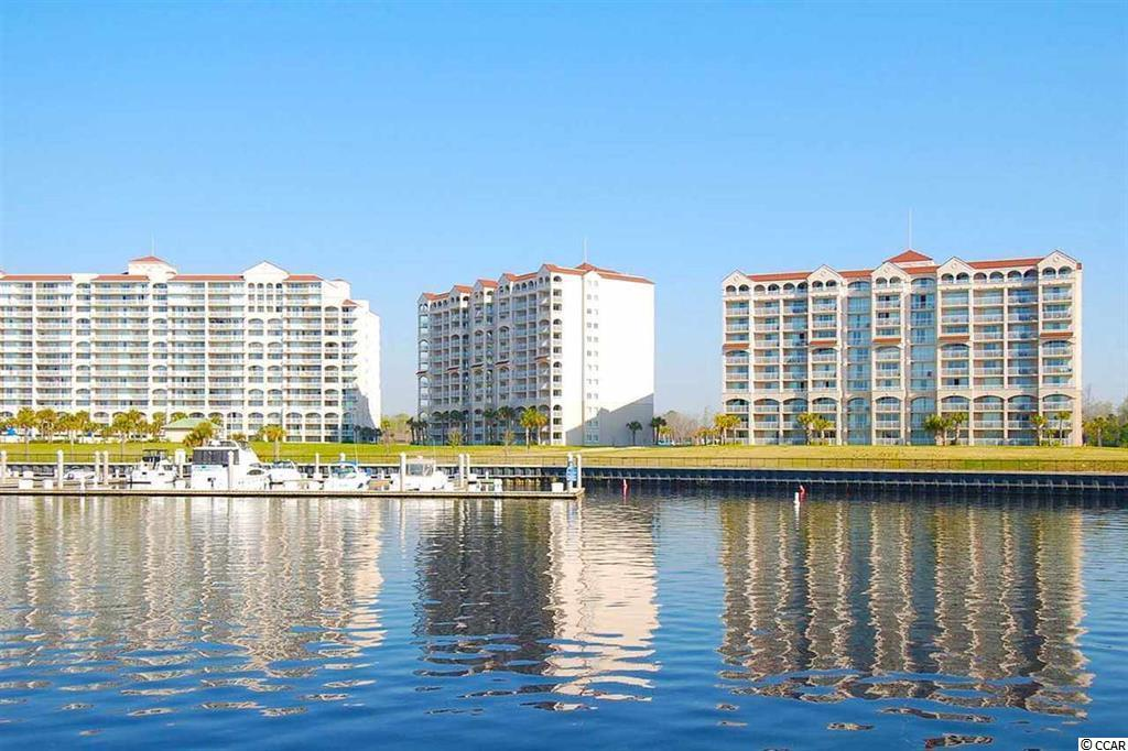 Have you ever considered care-free living in a luxurious condo community!? This TURN KEY 2 Bedroom lockout unit is spacious, and comes fully furnished & offers views for days overlooking the intercostal waterway & the largest salt water pool in SC! Two spacious balconies!! Not only are you seconds to popular Barefoot Landing shops and famous restaurants, but you also have endless Grand Strand beaches & amenities at your fingertips!!