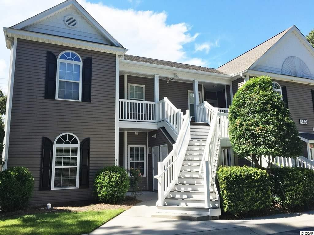 Live close to the beach! First floor, end condo is ideal for full-time living or a beach retreat. Located in a gated community, this well maintained 3 bedroom, 2 bath condo boasts a spacious split-bedroom floor plan and private screened porch. Engineered hardwood flooring is beautiful and easy to maintain. Plenty of room for storage, including a walk-in closet in the master suite and an exterior storage area to accommodate your beach/fishing/golf equipment. This community includes a pool and is close to area beaches, shopping and dining, medical facilities, and golf courses.