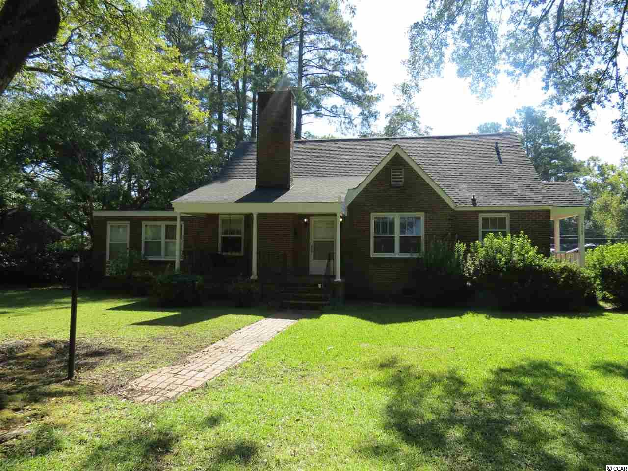 All Brick Veneer Home located on a corner lot in the beautiful neighborhood of Richmond Plantation. Features included hardwood flooring, formal dining room, living and family room, brick wood burning fireplace, pine paneling walls and ceilings, kitchen with solid wood cabinets with accent shelving and smooth top range. French doors separating the living room and family room, arch doorways, large laundry room with extra cabinet storage, back porch entrance with covered walkway from garage. Side and front porch with swing for outdoor enjoyment. HVAC unit new in 2017 and new roof in 2017.