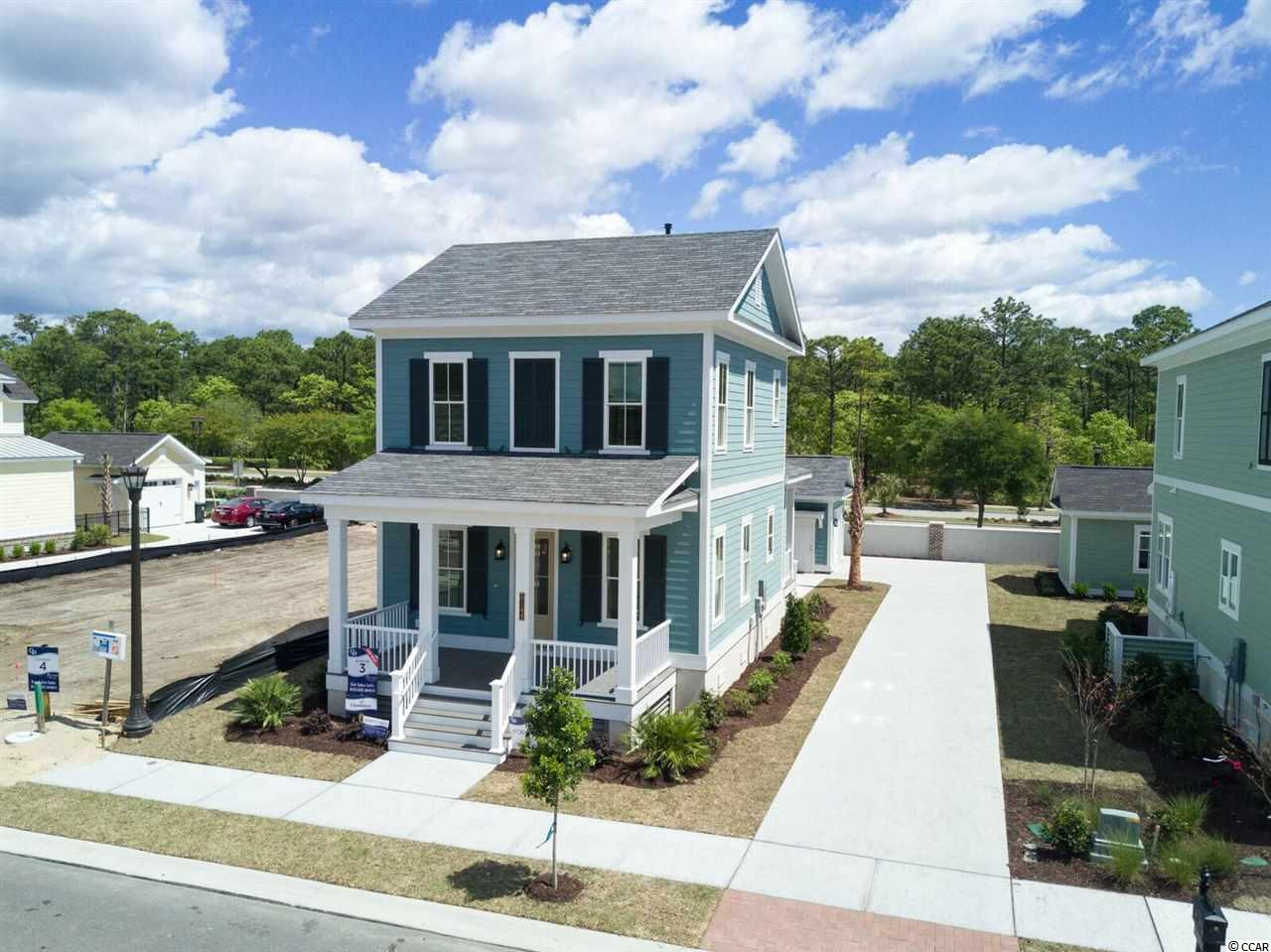 To-be-built home! At 1,793 heated sqft, the two story Charleston home located on Lot 9 offers 3 bedrooms with a first level master suite and 2.5 bathrooms. NOW SELLING at Living Dunes- New construction homes with lakefront and water view real estate available. A Grande Dunes neighborhood on the north end of Myrtle Beach less than 1 mile from the ocean featuring lowcountry style single and multi-family homes constructed by locally renowned, CRG Companies. Built with higher-grade materials and green construction methods that surpass regulations allowing you to own a quality home that is energy efficient and eco-friendly. Design your Living Dunes home with many upscale features that come as a standard including cutting-edge home technology. As Myrtle Beach's first Gigabit community, Living Dunes provides residents with internet connections 100 times faster than the average meaning more time spent doing what you want. Residents have superior on-site amenities with a swimming pool, kiddie pool, clubhouse, 8 miles of walking trails, 10 acres of lakes, and green spaces. Thoughtful design and unprecedented amenities, the community's location offers convenient access to the beach, Grande Dunes Ocean Club, Marina, golf courses, and several major marketplaces with groceries, pharmacies, shopping, dining, fitness, health care, salons, and more. Live Local, Live Smart, Living Dunes.