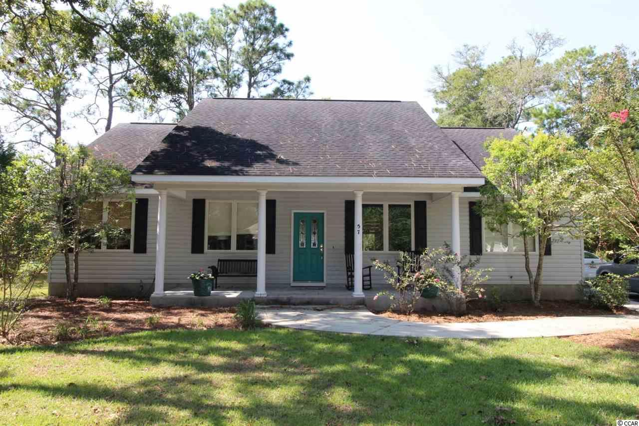 This quality custom built home is being offered for sale by the original owner. The home is located on a 0.53-acre lot with a spectacular, unobstructed view of the 10th Fairway at the Founders Club at Pawleys Island. The property provides complete privacy with its location being at the on the end of a small road shared by only four homesites. The spacious living room features vaulted ceilings and a fireplace. High quality wood floors throughout the home. There is a formal dining room. The master bedroom/bathroom offers all you could want from a custom-built home. The kitchen is open with easy access to the living room and dining room. The 2nd bathroom has a spacious garden tub. The screened-in (18 x 16) back porch is ideal for entertaining. There is a potting shed in the back yard with electric and water. The HOA is optional and the restrictions are minimal – boat, RV parking, detached storage buildings are all allowed. There is also a detached storage building which will convey. This home remained high and dry through Matthew and Florence. Located in the highly desirable Hagley Estates community in Pawleys Island and close to Hagley Landing on the Waccamaw River.