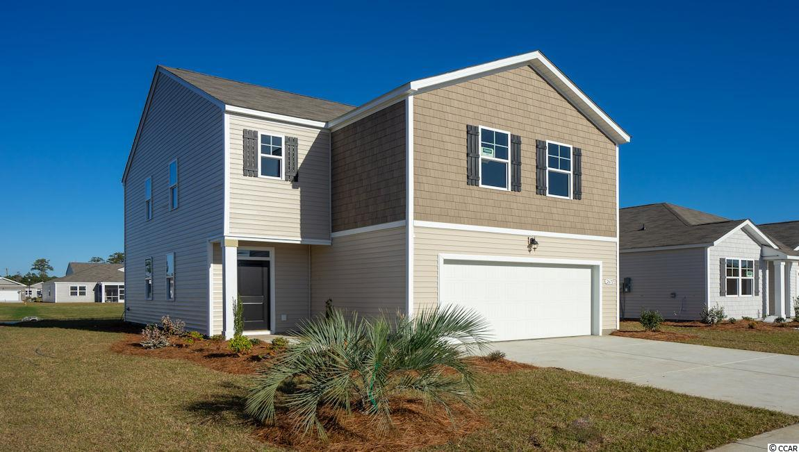MOVE IN READY!! This Elston plan home offers 4 bedrooms . Large owner's suite with dual vanities and 5' shower in bath. Nice, open flow between kitchen and living areas is great for entertaining around the large kitchen island. Low maintenance vinyl plank flooring gives the look of wood with easy care and cleanup! Granite counters in the kitchen, stainless Frigidaire appliances. Bathrooms have cultured marble countertops with undermount sinks. Covered rear porch for outdoor living space looks out over the water, which has a fountain. Low community HOA fees. Be one of the first to live in Meridian at Market Common. The Meridian will offer 200-300 new homes, featuring 8 floor plans both ranch and two story homes. We are the price-leader for single family homes in Market Common! Our home owners will enjoy a gracious pool, open air amenity center, pickle ball court, walking trails and a short golf cart ride to the beach. Live like you're on vacation! Home and community information, including pricing, included features, terms, availability and amenities, are subject to change and prior sale at any time without notice or obligation. Square footages are approximate. Pictures, photographs, colors, features, and sizes are for illustration purposes only and will vary from the homes as built. Equal housing opportunity builder.