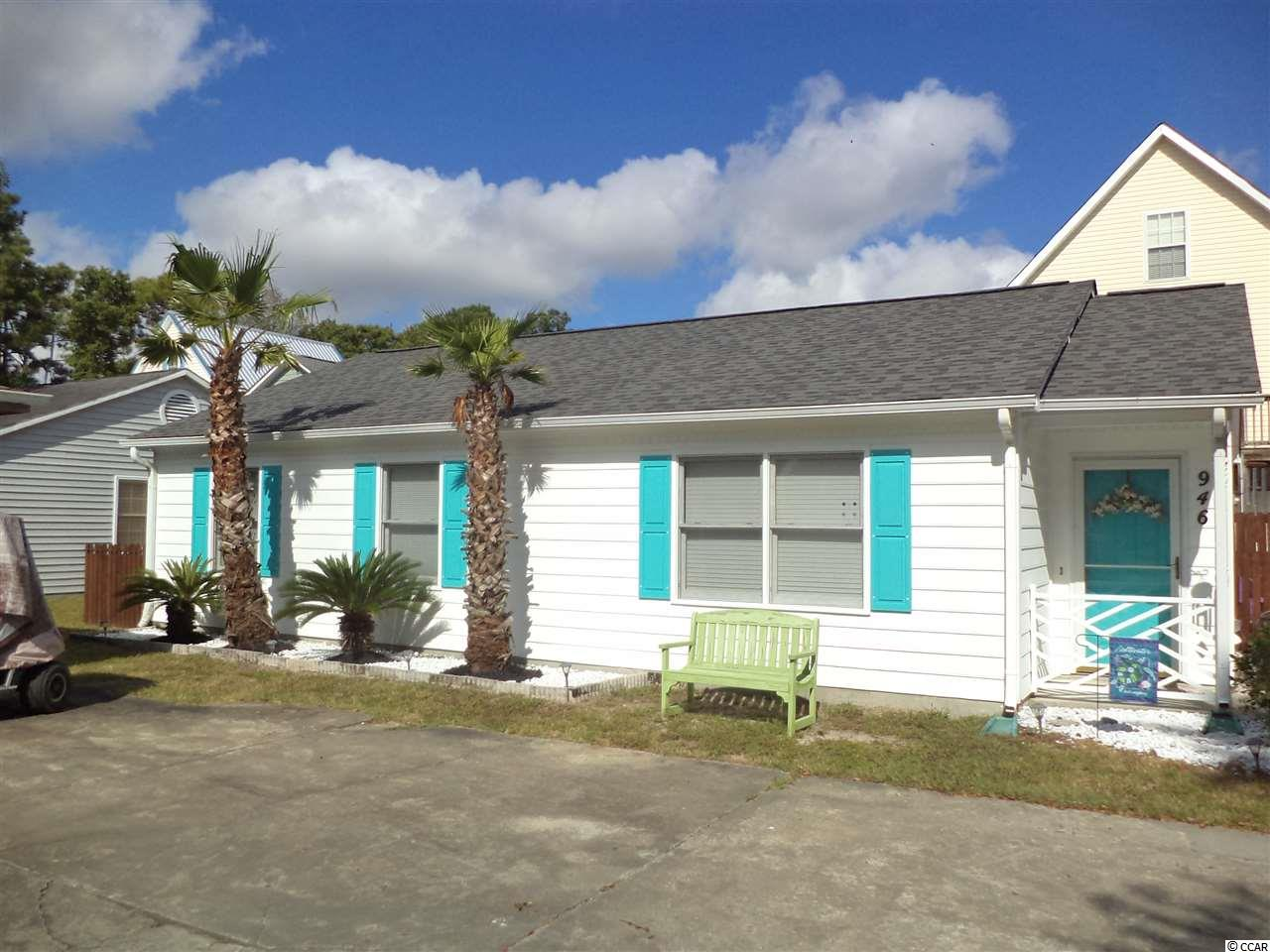 Welcome to Tiffany Plantation in Ocean Drive! You will fall in love with this adorable 3 bd/2ba beach home just a few blocks to the beach. Quality upgrades to include Bamboo flooring, newer carpeting in all bedrooms, brand new back and side doors, New Architectural Shake Shingle 30 yr. roof placed in July 2018, newer high efficiency HVAC unit only 3yrs. young, house painted in 2017. Attic and outside storage space for all of your supplies and a full size laundry room. 2 car parking and of course room to park your golf cart as well! Lovely community pool to sit and relax or take a quick dip after a day at the beach, perhaps sit in the lovely side yard which is completely fenced in (great for your furry babies) with friends and family for a BBQ and listen to the ocean waves.. A charming quiet community with low monthly HOA fees which includes your lawn mowing too.. wow! Minutes to Main St. the heart of North Myrtle Beach and quick access to Hwy. 31 to take you to all of the attractions the Grand Strand has to offer. Call today for your showing before this one gets away.