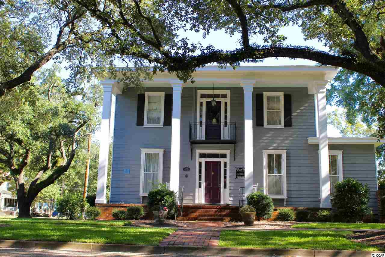 c. 1850 also known as the  Rebecca Susan Byrd House, 232 King Street, is located in the heart of Historic Georgetown. This home has beautiful hardwood floors throughout, with a formal dining, eat in kitchen, paneled study, and a gorgeous Carolina Room opening up to the fenced in side yard. Four bedrooms and two full bath are located on the second floor. Currently being used for storage, a 21'x22' heated and cooled area was previously a 2 car garage, with potential to be converted back to the original use. The kitchen was recently updated with granite counter tops, stainless steel appliances, and newer HVAC. This is one of the few homes in Historic Georgetown with a basement! 232 King Street is truly a must see home, within two blocks from the waterfront, museums, shopping and dining.