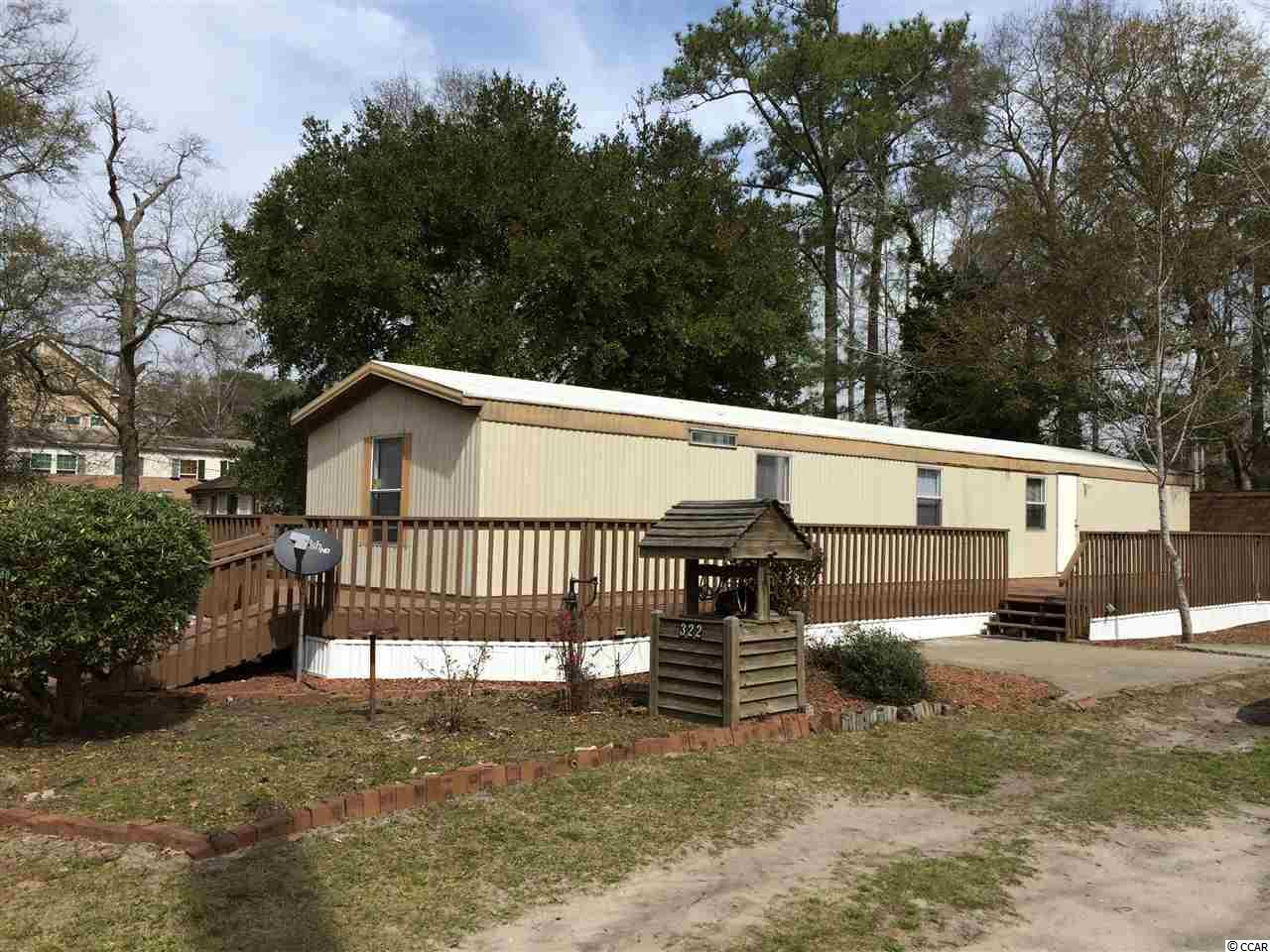 BEAUTIFUL LARGE LOT IN GARDEN CITY BEACH WITHIN A COUPLE OF BLOCKS OF THE BEACHES OF THE BLUE ATLANTIC!  MOBILE HOME NEEDS REPAIRS.  BUY TODAY AND BUILD AT YOUR LEISURE.  VISTA DRIVE IS A STREET WITH MANY NEWER, BEAUTIFUL HOMES.