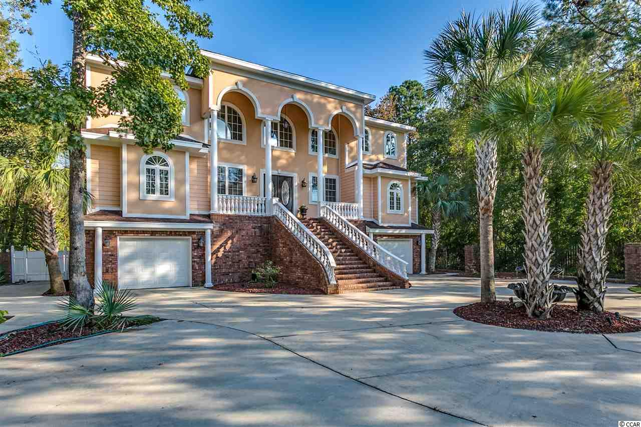 Custom built one of a kind 5500 heated square foot home in the Litchfield area of beautiful Pawleys Island. Only 4 blocks from the beach, the property features 6 bedrooms, 6.5 bathrooms, spacious layout. Priceless easy access to the ocean. Huge lot with large back yard and perfect pool area to enjoy. Covered out door areas by the pool. Along with spacious screened in porch over looking the pool. The entire bottom floor has a bedroom, bathroom and a living area with a separate entrance that can be utilized as a mother-in-law suite.  Beautifully landscaped yard with Palm trees accenting either side of the grand front staircase. The Widow's Peak on the top of the house is where you can feel how peaceful this home truly is. Please call with questions or to schedule a viewing.