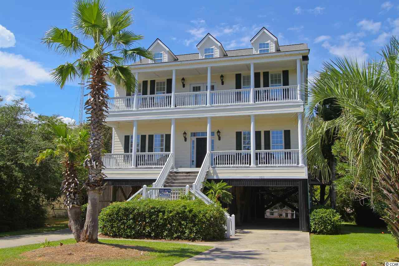 This lovely 4BR/3BA 2nd row beach home, with its inviting porches and beautifully landscaped surroundings, has the flair of a Lowcountry paradise. Sit and relax while enjoying your favorite beverage on one of the spacious porches that adds a wonderful extension of the indoor living areas to the outdoors. The 2nd floor porch offers breathtaking views of the ocean. This home sits on a very appealing homesite with mature landscaping, lush greenery and inviting swimming pool to add to the tropical ambiance of your personal paradise with only steps to desirable North Litchfield Beach. You will love the details of this perfectly planned Lowcountry style home with  hardwood floors in main living area, crown moldings throughout and much more. The well-appointed kitchen of this home features granite counter tops with breakfast area. The large master bedroom suite has two walk in closets and master bath with jetted tub.  Underneath this raised beach house you will find plenty of parking space and storage for beach toys such as boats, surfboards, kayaks, golf cart, etc.  This marvelous property displays a myriad of features and fine appointments that are too numerous to mention. This slice of paradise is conveniently located near Brookgreen Gardens and other beautiful beaches of the Atlantic Ocean such as Pawleys Island and Huntington Beach State Park, restaurants, shopping, art galleries and medical facilities. North Litchfield Beach is known to be one of the best kept secrets on the east coast!  For those seeking an active lifestyle, there are miles and miles of bike trails and many world class golf courses. This gorgeous Lowcounty home that is great for daily living as well as gatherings and entertaining, is calling you to make it your home. Come, relax, play and have fun in the sun at Pawleys Island, South Carolina, where you can feel like you are in your in paradise. You can enjoy everything that Myrtle Beach has to offer for the day or evening and return back to the laid