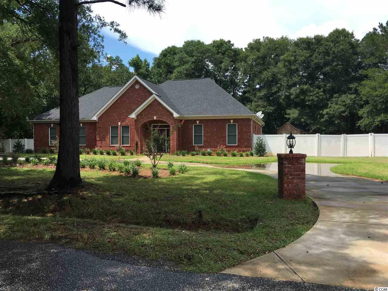 BEAUTIFUL ALL BRICK 3 BEDROOMS, 3.5 BATHS HOME!  This home was built in 2015 and is walk-in ready. It is situated on 1.1 Acres. This lovely home has a manicured lawn and privacy fence.  Large bedrooms with screened patio entrance from Master Bedroom, open spaced great room, large backyard, state-of-the -art kitchen with stainless steel appliances; huge 2-car garage with upstairs storage room, and includes an additional shed outside.  GREAT FEATURES makes this home very special.