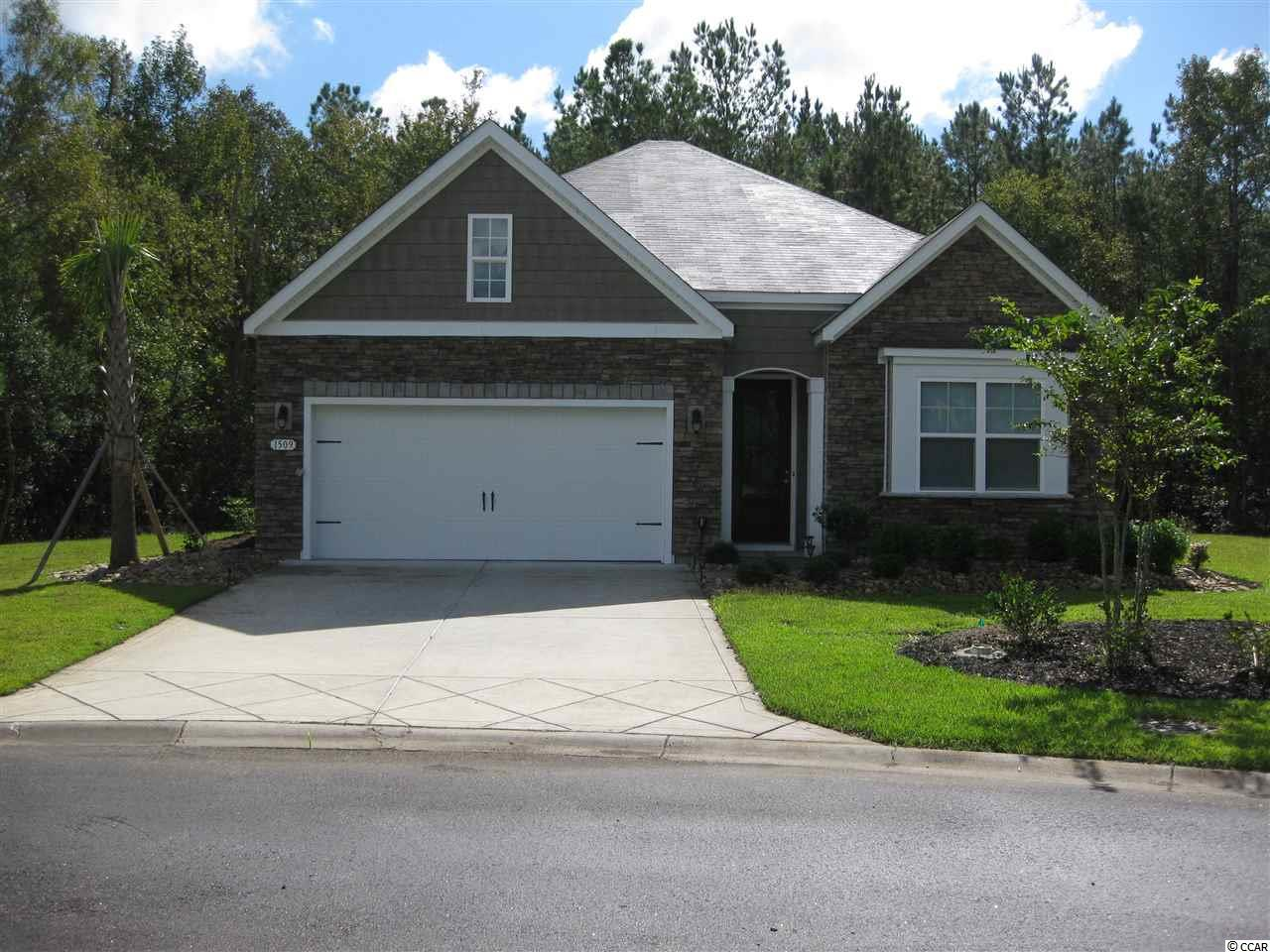 This 4 bedroom/2 bath home shows as if it was never lived in, IMMACULATE! Protected wetlands behind house so there will never be anything built there. Seller has had no flooding problems whatsoever. An occasional deer has been seen and lots of other wildlife. Enjoy your huge kitchen island with granite counters and stainless steel appliances. Split bedroom plan. Fireplace in living room.