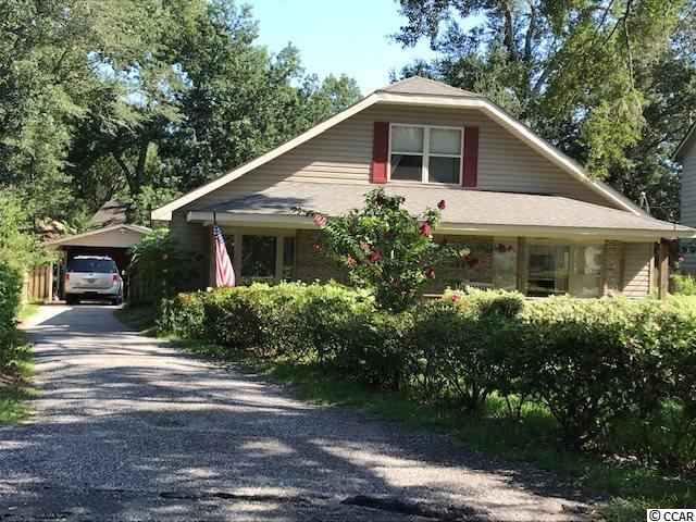Quaint beach cottage nestled on .23 acres in the heart of Windy Hill. Golf cart ride to the beach & Barefoot Landing. Home features 3 bedrooms, 2 1/2 baths, bay window in dining room, brick fireplace, den area off kitchen, sunroom, and laminate floors living room/dining room/master bedroom & upstairs. Recent updates include downstairs HVAC & hot water heater 4 yrs. old, upstairs HVAC 8 years old, new windows 8 years old, new roof 10-12 years old. Home setting is fenced in with lush green landscaping.