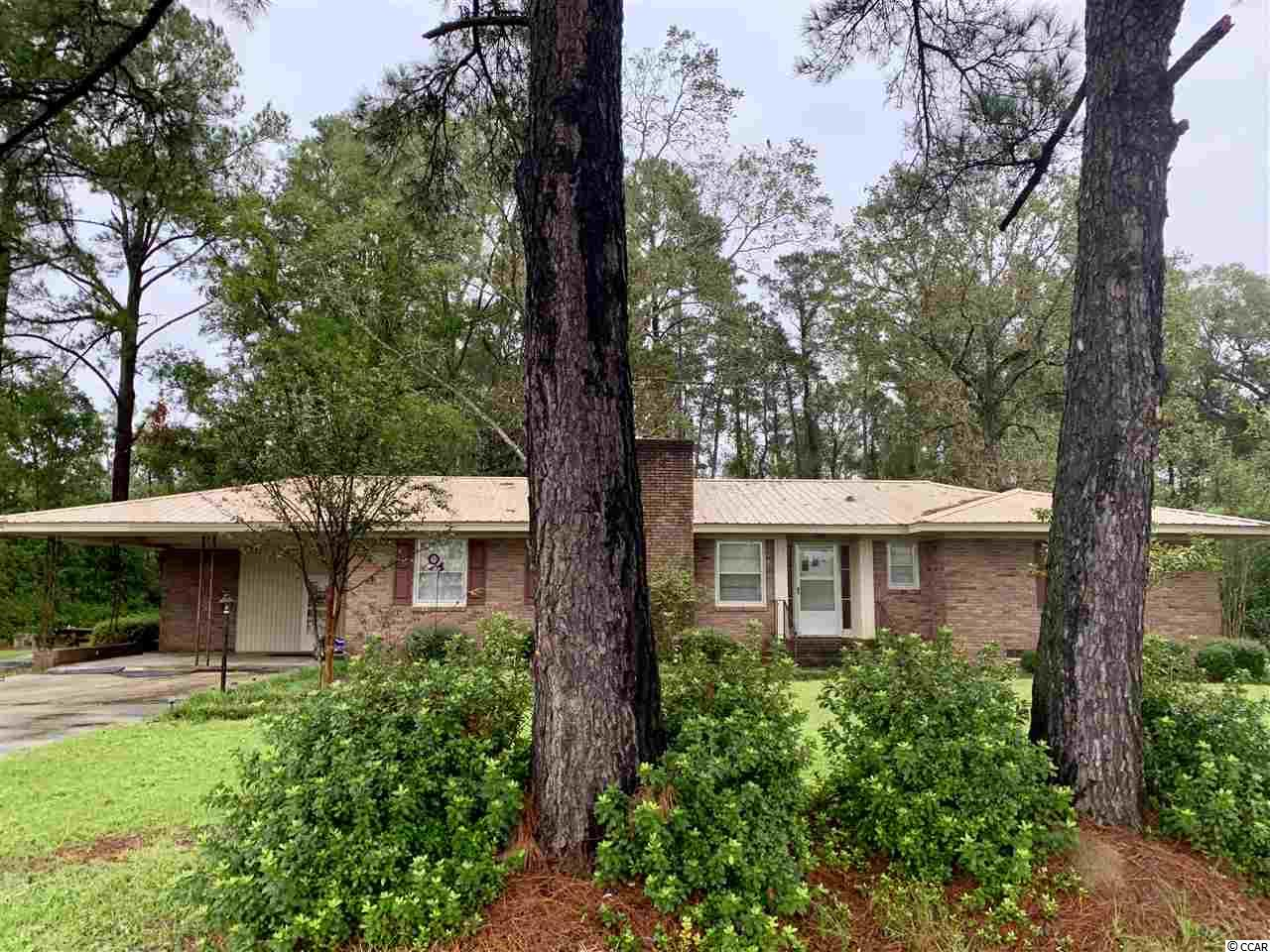 WOW! This is a RARE find on Highway 501 W in Conway! This lovely all brick home is minutes from all the shops and grocery stores in town! This home has been well maintained, and has beautiful mature pines and shrubbery. This 3 bed/2 bath has a large floor plan, and gives anyone true comfort in the home. There is an attached two-car carport, and detached two car garage behind the home. Home is sold as-is due to owner never occupied. Currently is used as a rental home. Perfect for primary residence, rental, or business. Home sits on a comfortable 1.6 acre lot.