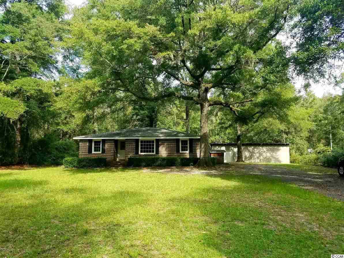 Great brick home with a large detached workshop that is nestled between two private plantations. This location is very close to a public boat launch that gives immediate access to the Intracoastal Waterway as well as Winyah Bay, all other surrounding waterways and the Atlantic Ocean. This property has been partially renovated. There is a generously sized kitchen with breakfat nook and den. Hardwood and tile flooring in most of the home. The yard, 120'x239'x109'x242', is large enough for possible additions and all of your toys. Historic Georgetown is only minutes away and Pawleys Island beaches are just across the bridges. Make this special property your new home and enjoy country living just outside of town! Square footage is approximate and not guaranteed. Buyer is responsible for verification.
