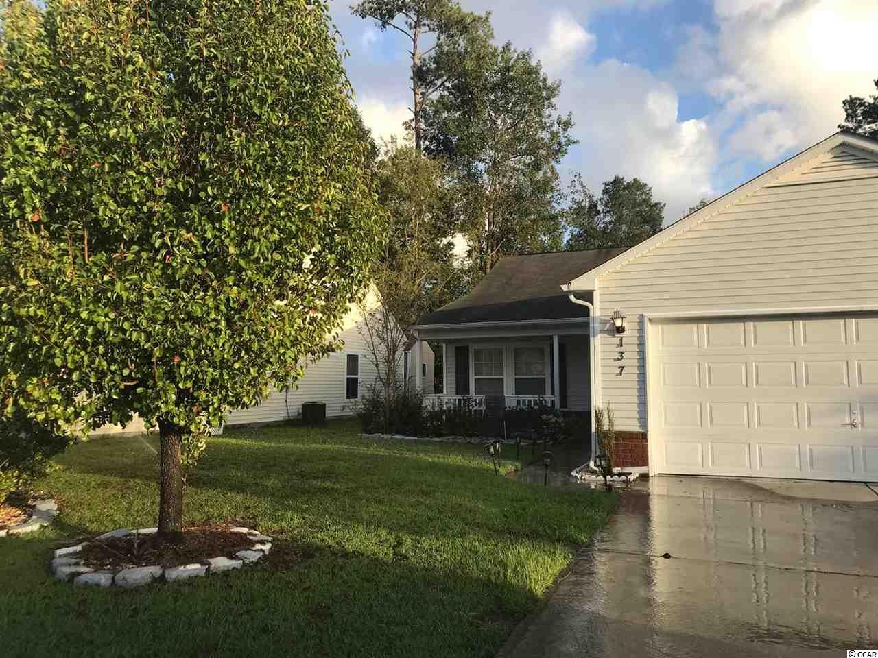 Spectacular floor plan, close to beaches, entertainment, shopping and many more. This house have outstanding features like a Carolina room , extended patio , fenced backyard and vaulted ceilings.