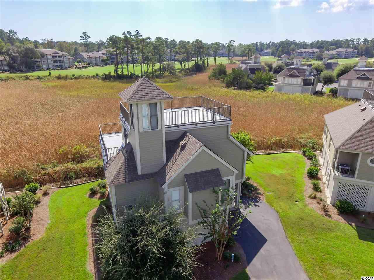 """Oh My,"" how clean and beautifully decorated this property is.  The living room overlooks the marsh and the 18th of the Tidewater golf course. As one goes to the top of the house which has a roof access, the views of the Intercoastal Waterway simply wow you. Harbor Loft is known as a site condominium. Fees include all landscape maintenance, painting of the house, annual termite inspection, use of the community pier and daydock. No over night docking. As a part of Tidewater, an owner has access to two swimming pools, 4 tennis courts, fitness center and an ocean front cabanna.  The community has 24 hour watchmen and a manned gate for entering.  No golf carts or motor bikes are allowed."