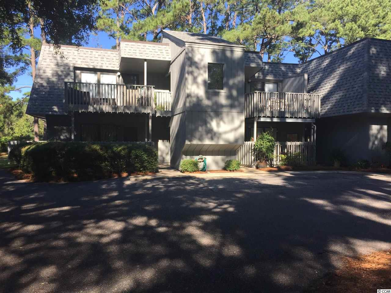 This 2 bedroom unit is in a well established community with beautiful live oaks. This unit is on the ground floor and is an end unit. Close to to the beach, fine dining, shopping, and golf courses. This unit has new flooring and fresh paint. Some upgrades needed but would make a great vacation home, rental investment or a permanent home close to the beach. HOA includes pool, club house, and community dock on the creek. The square footage is approximate and is buyers responsibility to verify.