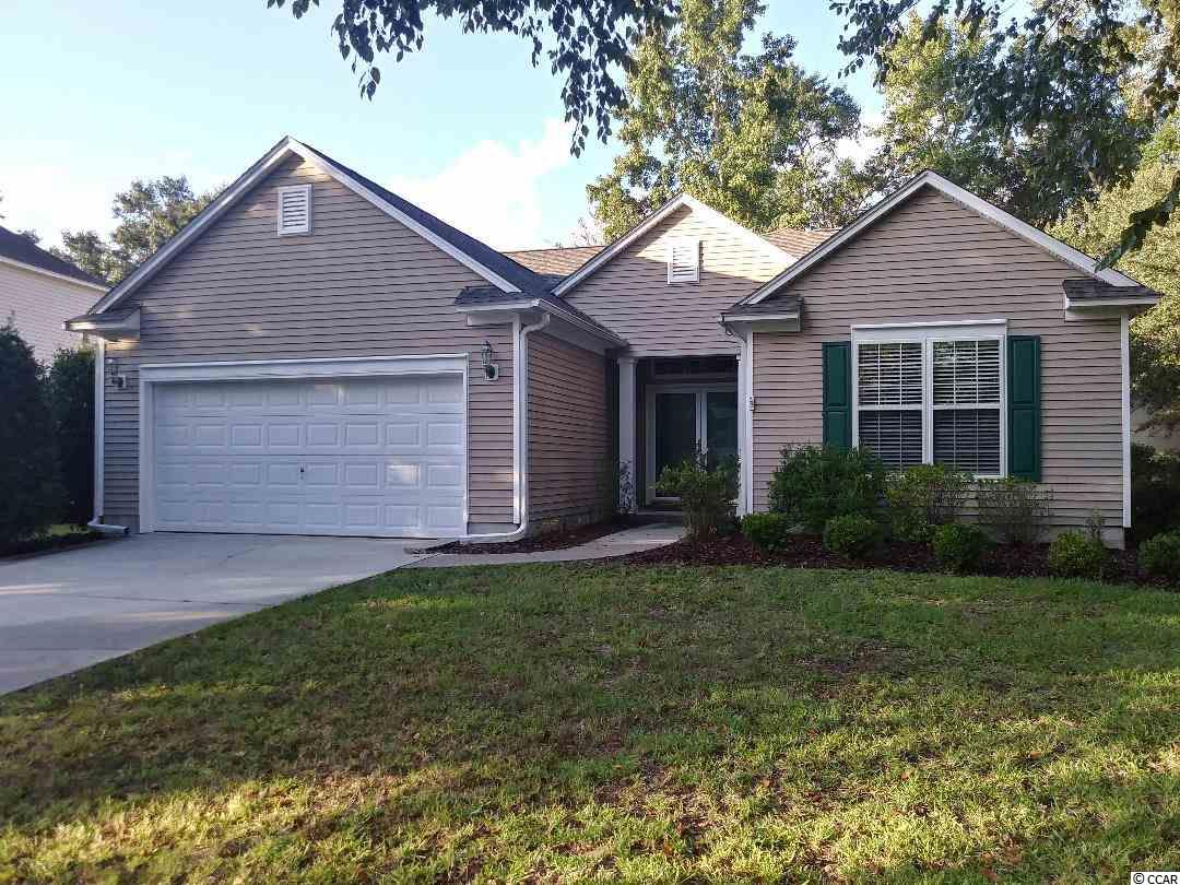 This open and split bedroom floor plan is located in the highly desirable Tradition community with pool, tennis courts and clubhouse. New roof October of 2018. The large open living area has built-in cabinetry and the many windows throughout provide an abundance of light and airiness with a screened porch off the living area. Kitchen features an eat-in breakfast nook and 42 in. cabinets. Master bath with double sink vanity, tub and shower. HOA includes private beach/ocean access to Litchfield by the Sea with walking/biking path, tennis courts, restroom facilities, fishing and crabbing docks, outdoor showers, open and covered decking and rental use of beach clubhouse. Access with fee to the marina at the nearby Reserve.