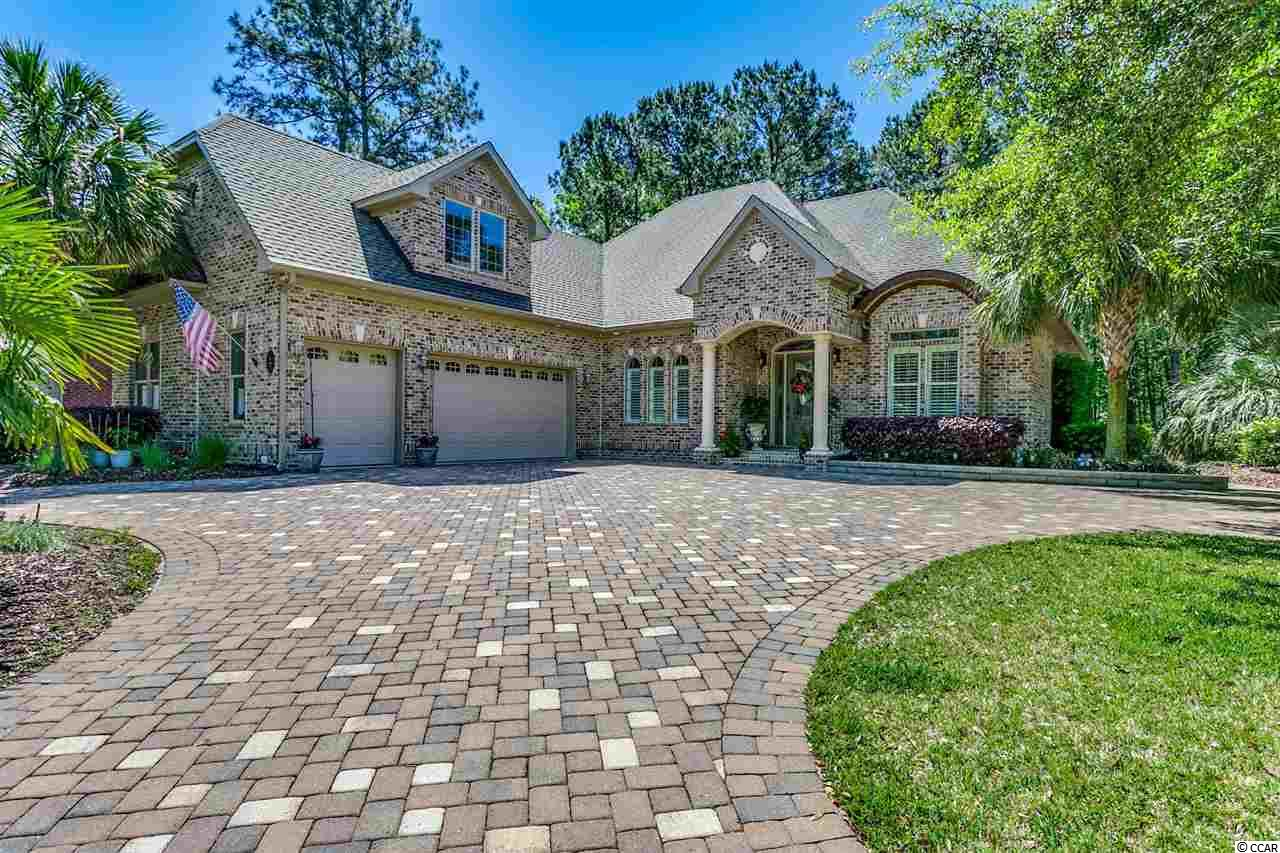 Gorgeous Custom Built Brick Home By Littlejohn Homebuilders and Designed By Craig Marz. You will love this home and location on a private corner lot and within walking distance to Heritage Plantation Marina which is located on the Waccamaw River and Intracoastal Waterway. This home has unbelievable quality from the Bluewood Building materials which protects against mold, mildew and termites to the Elk 160 MPH shingles with Grace Tri-Flex synthetic underlayment and includes the closed cell spray foam insulation for airtight fortified construction. There are so many enhancements ....tank less propane hot water with central hot water recirculation heater and pump, Four zone Trane 19 Seer HVAC with separate humidity control units, impact-plus low E glass and transom windows throughout, central vacuum system, central intercom, multi-room audio system, theater surround sound system, Cat-5 wiring and climate controlled attic. 10 foot ceilings with 8 foot solid construction doors, rope lighting in tray ceilings with crown molding in various rooms, 9 foot sliding pocket door in the 14 x 18 Four Seasons room which features 16 foot ceilings, travertine and granite fireplace, bull nose corner bead, porcelain tile and hardwood flooring throughout. Custom kitchen with many upgrades including top of line cabinets with rope lighting, granite counter tops , travertine and glass back splash, wet bar and walk in pantry. Large master bath featuring a two tiled walk in shower and a therapeutic tub. Custom wood shelving in all closets plus master closet with built in drawers. Outside features multi colored paver driveway, walkway and two level raised paver patio, 12 volt landscape lighting system, 30 nozzle insect spray system, retractable remote patio awnings and a tri-level waterfall. Micro irrigation for shrubs and plants and raised flower beds with lots of perennial flowers. 500 gallon in ground propane tank with connections for grill and electrical components installed for a generat