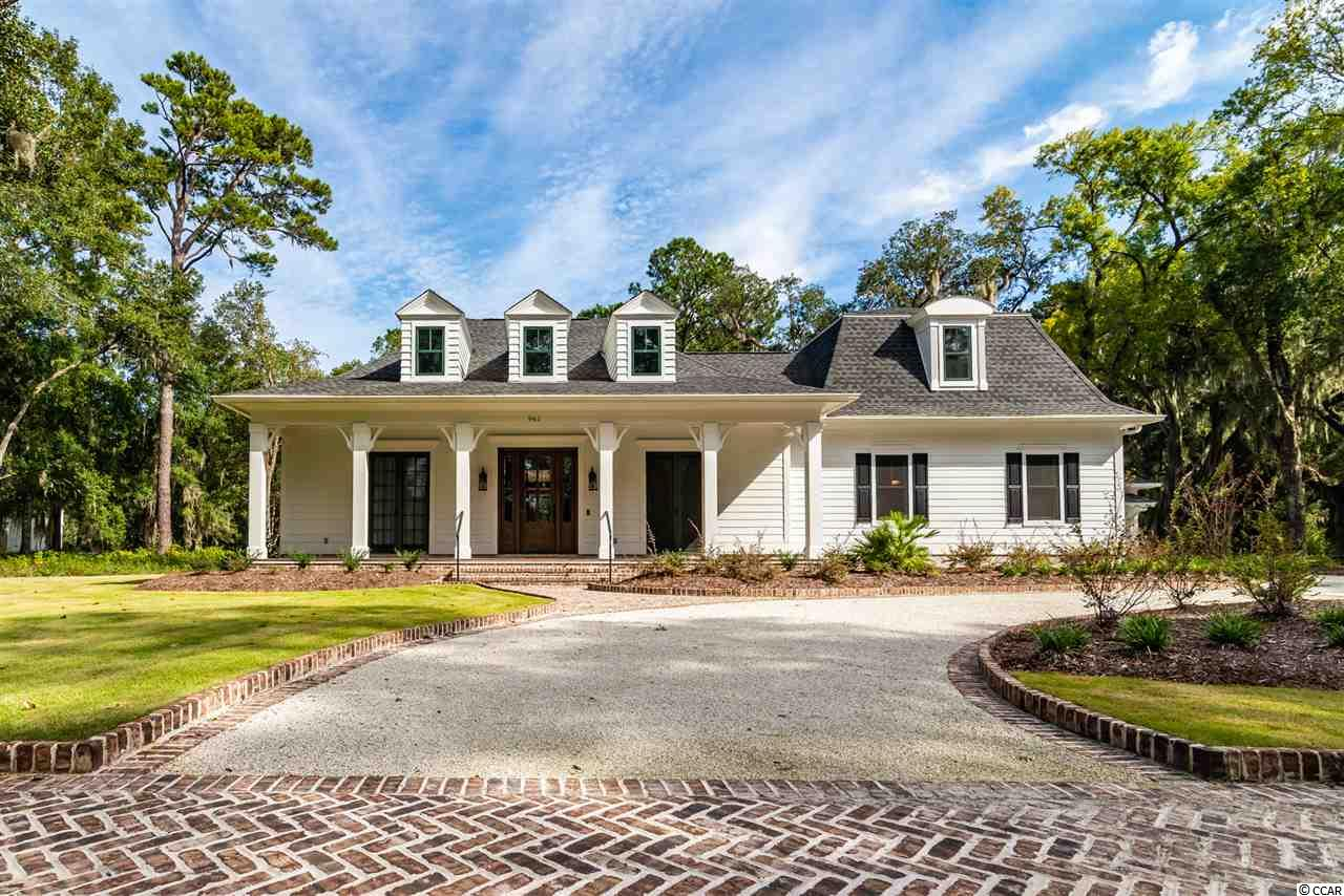 "CHRISTMAS REDUCTION!! This ""Classic "" custom built low country home by one of our areas premier custom home builders, ""Classic Homes"" would be the perfect Christmas present for you and your Family! Debuted as the 2017 & 2018 Southern Living Showcase home in Litchfield Plantation, this 4 BR and 3.5BA open concept home is nestled among the large live oak trees in the older section of Litchfield Plantation. Home is NOT in a Flood Zone. Absolutely stunning! Beautiful lush landscaping around the house, w/ brick patterned circular drive draw your eyes to the immaculate care and detail with which this home was built. Nothing less than awe inspiring. 2 car side load garage and additional garage/storage with entry door that could be a weight room, man cave, or artist studio. Come step inside the home for the finer details.., Gourmet Kitchen w/ large Granite Island, beveled glass custom backsplash, double ovens, 6 burner gas stove, wine fridge and all the bells and whistles, dramatically gorgeous tile bathrooms, wired for sound inside and out, custom lighting, large mudroom/laundry with additional sink and storage, First Floor Mater Bedroom w/ shiplap feature wall, and double closets, Mater bath w/ soaking tub and rain shower, Brick back porch w/ brick gas fireplace, deep tray ceilings with back lighting, custom built-ins in living area, French doors from the dining room and front bedroom w/ screens, plantation shutters throughout. Security System. Sprinkler system.Master Grillers dream Grill and large back patio look out to a spacious lot with scenic views of moss draped oak trees. Guard gated Community w/ Pool, beautiful walking trails, Marina, Litchfield Plantation residents have use of a Private Beach home w/ bathrooms and parking on Pawleys Island if they want to spend the day at the beach. Home was built in 2018 and remainder of Builder warranty in effect."