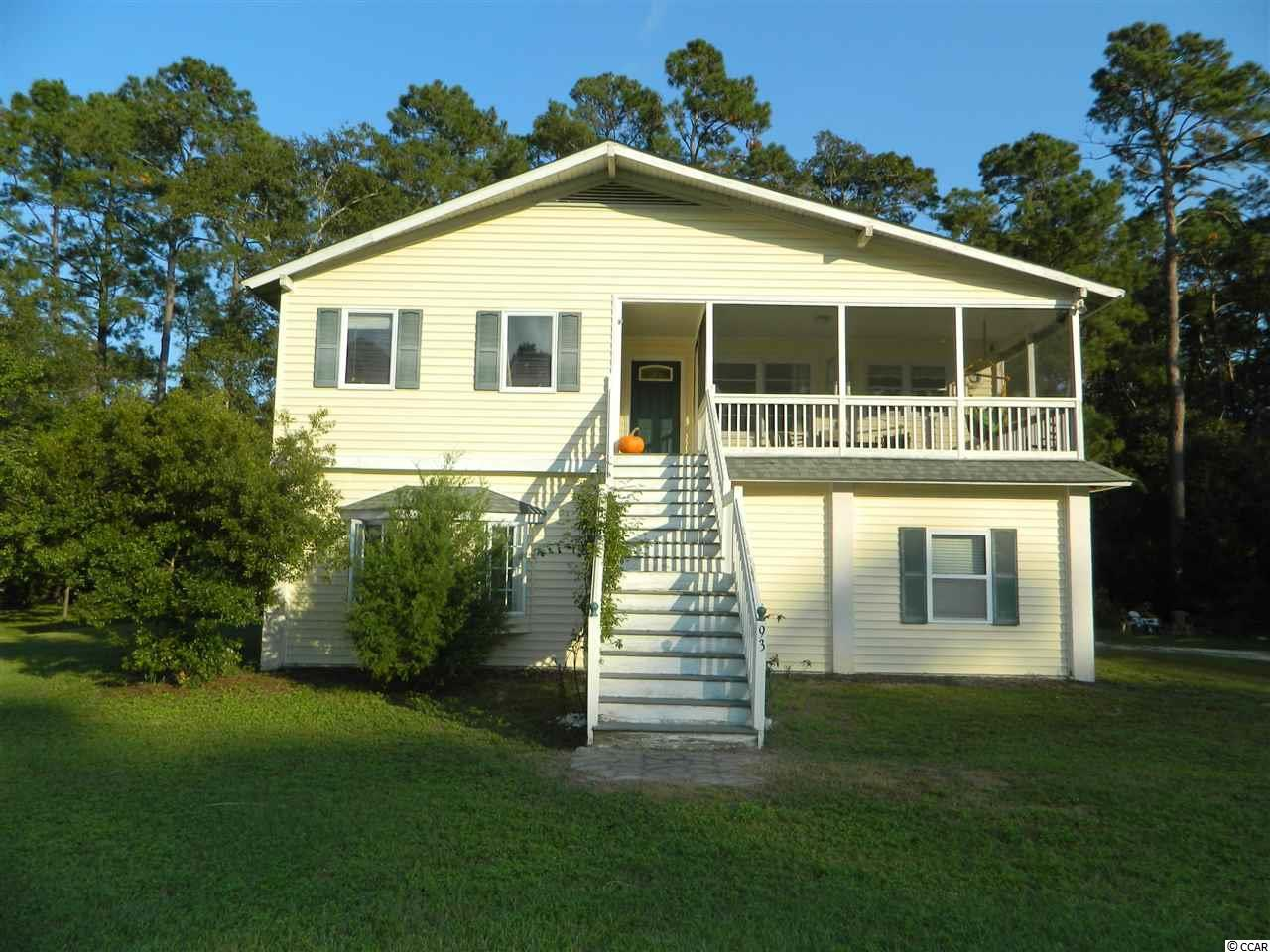Truly a rare find - a NON-HOA property in the highly desireable North Litchfield section of Pawleys Island! This is a fixer upper with two floors of heated living space situated on a quiet cul de sac. It's a short walk or ride to the ocean at beautiful North Litchfield Beach and Waccamaw Intermediate School. The upper level has an open floor plan with an unfinished master bath/large walk in closet. It has a rear deck overlooking the backyard woods and a screened in front porch. The first floor boasts tongue and groove pine plank 9 foot ceilings and plenty of storage area, and with much of it living space left partially unfinished, you'll have a virtually blank canvas to make it your own! This hidden gem is perfectly situated for easy access to the pristine settings of Huntington Beach State Park and Brookgreen Gardens, the Waccamaw Neck Bikeway, and the Intracoastal Waterway, and some of the best golf courses on the Grand Strand, along with all the entertainment that Pawleys Island and Murrells Inlet have to offer.