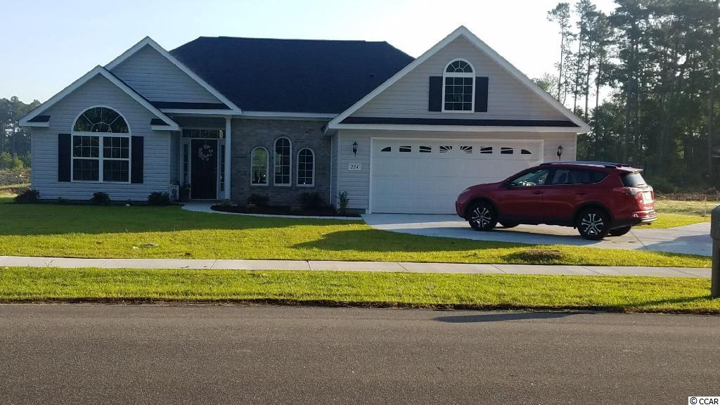 Home is almost complete, drop by the property anytime to check it out! This home is 3 of 6 to be built in the desirable, established community of Conway Country Club. NO HOA! Come by to see the soaring ceilings and wide open spaces! Picture of floor plan does not show the 13.4 x 11.8 Carolina Room. No lot premiums for this beautiful lot. Call today to get all the details on this fantastic home. First front shot is the current home being built. Some of the inside photos on listing are from home with same floor plan that has already been built. Colors may vary. Pick your floor plan pick your colors!