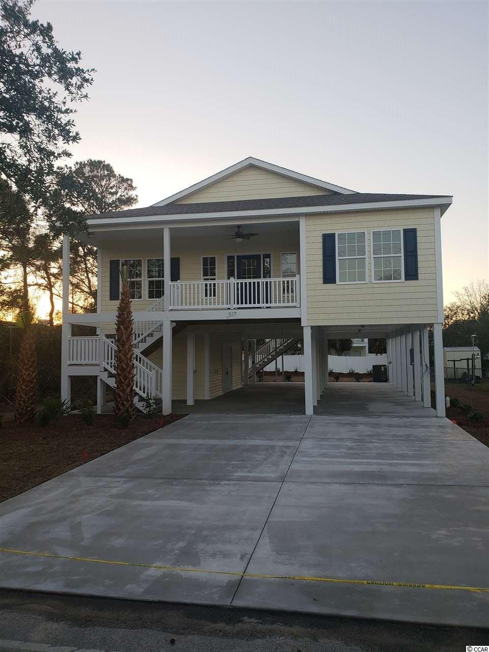 4BR / 3BA new raised beach style home east of Hwy 17 in NMB. Home features 9 & 10' ceilings, crown molding, custom kitchen with granite and stainless appliances. Master suite has his and her sinks and closets, full tile shower. Ceiling fans and wood floors throughout. Fully landscaped yard with concrete driveway.