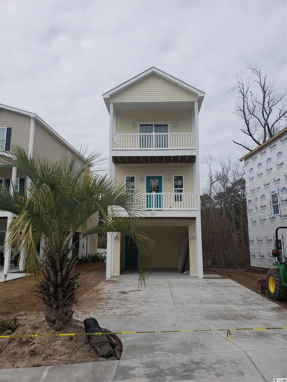 3BR / 2BA / 1328HSF new construction home. great floor plan with master bedroom and office / guest bedroom on top floor - all living space on mid floor and guest bedroom suite on ground floor. Kitchen features custom cabinets, granite countertops, and stainless appliances package. Turn key completion with concrete driveway, fully landscaped and irrigated yard. Easy golf cart distance to beach, shopping restaurants and that NMB has to offer.