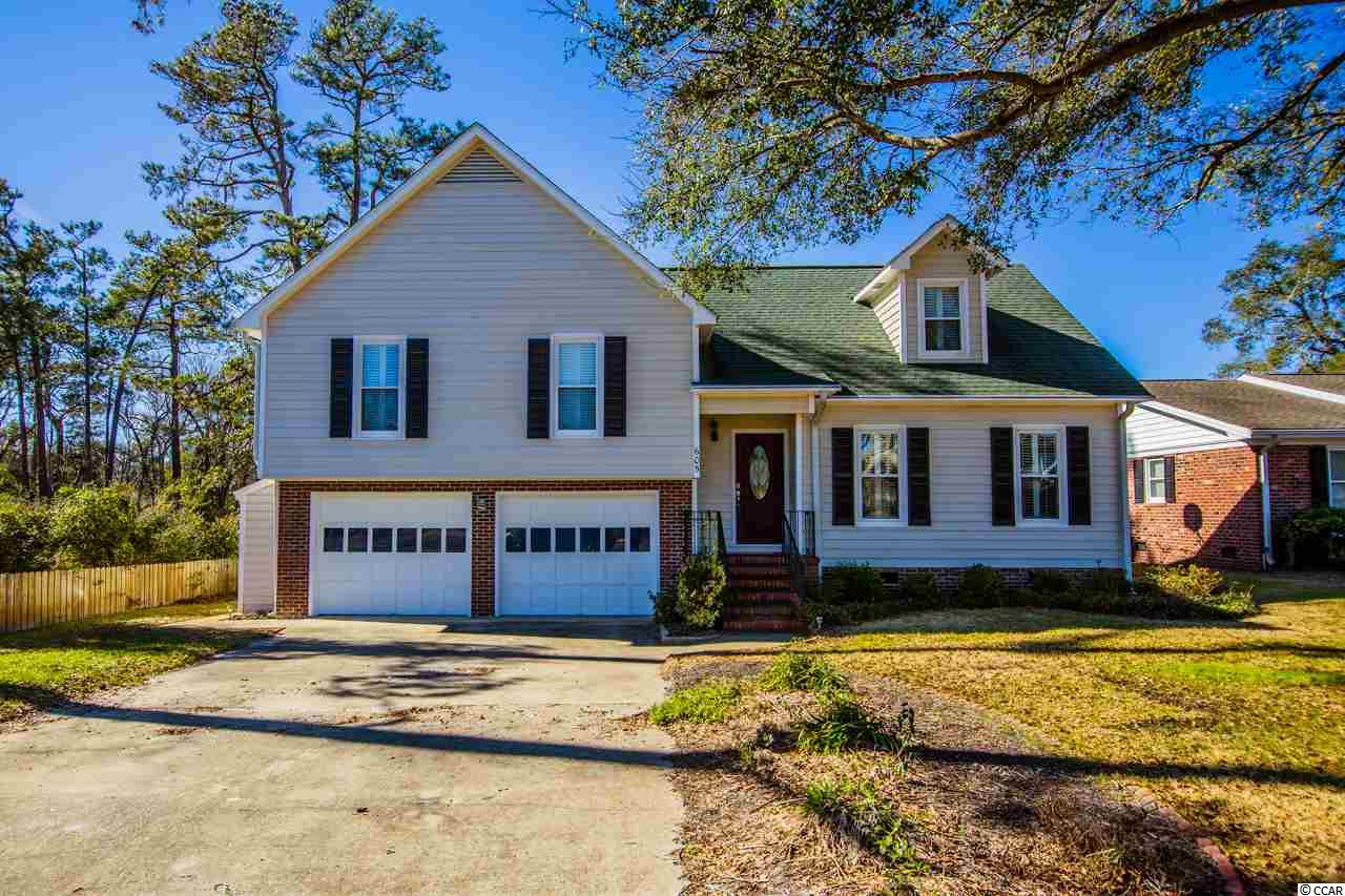 Wait no longer! This 3 level colonial which has just been freshly painted is only minutes from North Myrtle beach by Golf Cart, and is located on east side of 17. Living Room has built in entertainment center, with surround sound, flanked by built in bookcases. Wood floors, a 12 x 18 Carolina Room with floor to ceiling windows that overlook the in-ground pool. This gorgeous house has two master suits with fully tiled bath and shower. Fenced in yard with covered seating area with deck that surrounds the pool. For your convenience there is an outdoor shower and a half bath in the garage. Your two plus car garage has built in storage and a work bench. A must see if you want to be near the Ocean in North Myrtle Beach. Windows coverings made of Kevlar