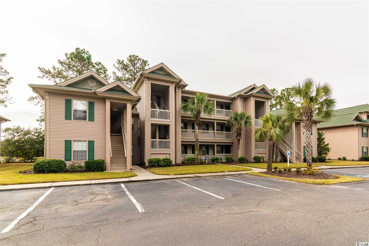 Ground floor 3BR/3BA unit with hard wood floors and great location on True Blue golf course in Pawleys Island. All appliances and furnishings convey. This unit is located in the heart of Pawleys Island and provides easy access to dining, shopping and events. Enjoy a view of the golf course while relaxing on the screen porch. Unit features a comfortable living/dining room combination and allows long or short term rentals. True Blue is located close to the beach, shopping and dining, and about 30 minutes from Myrtle Beach and approximately one hour to historic Charleston. Sold fully furnished. Located in building 12 this unit is close to tennis, pools and hot tubs. Square footage is approximate and buyer is responsible for verification.