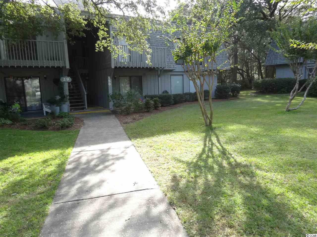 This condo is located 5 minutes from the beach. This is a first floor unit with 2 bedrooms, 1.5 baths. Many updates. Remodeled kitchen now has large breakfast bar with lots of storage. Living room has a sliding glass door to the patio. Living room, dining and kitchen have laminate flooring. Bedrooms have carpet. Salt Marsh Cove offers a swimming pool, clubhouse overlooking the lake, and a dock on the saltwater creek. Conveniently located on the mainland at Litchfield Beach with all the conveniences of grocery stores, restaurants and shopping nearby.