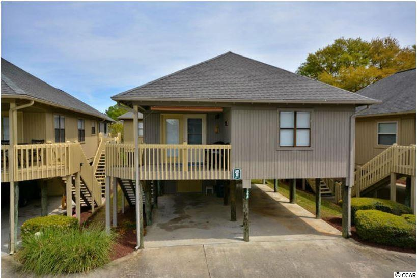 Sun-sational 2 bedroom, 2 bathroom raised beach home, FULLY FURNISHED and only a short walk or golf cart ride away from the beach! Vaulted ceiling and open floor plan combine to create a warm and welcoming space. Kitchen boasts Stainless Steel appliances, tile floors and ample storage space. Master and guest bedroom are conveniently located just off of the main living area. This home has been lovingly maintained, with new windows throughout the home and a new hot water heater. Full-size washer and dryer, located just off the main living area, make laundry a snap! Attached storage located underneath home is the perfect spot for storing beach gear. Sparkling blue outdoor pool for splashing the Summer away. Incredible location makes this home the perfect primary, secondary or investment property! Shopping, dining, entertainment and golf are just mins away!
