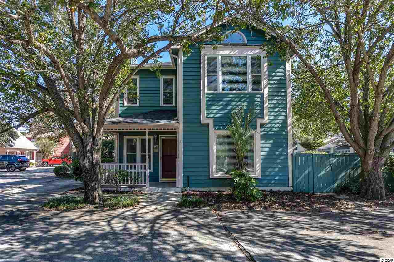 "Fantastic beach home with an incredible location at a great price. 3 bedroom, 2.5 bath home in Tiffany Plantation just a few blocks to the Atlantic Ocean. Well-maintained home with new vinyl windows in 2011, new hot water heater in 2016, new roof installed approx. 2009, and hardy cedar wood siding repainted in 2014. Kitchen has had cabinets replaced with solid wood cabinets, new stainless microwave (2016), new refrigerator (2012) and a new sink faucet. Laundry room and pantry are just off the kitchen with side by side washer & dryer that convey and additional cabinetry. 12"" tile floors are in the dining room and living room while all bedrooms have carpet. The sizable dining room has a large window for plenty of sunlight, new hanging light and French doors leading to the huge 40'x14' patio enclosed with a solid brick privacy fence and a large tree which provides partial shade for the hot summer days. There is also a shower in the patio area. The living room has a ceiling fan and a wood burning fireplace for chillier winter nights, and nice white bead board on lower half of the wall. The master bedroom is on the first floor with a large closet and a bathroom with a tub/shower combo. Upstairs you'll find a large guest bedroom with a huge walk-in closet (10'x6'). The 2nd upstairs bedroom is even larger…it's more like 2 bedrooms in one. This bedroom also has a huge walk-in closet (6'x8') and gets plenty of sunlight with a partially vaulted ceiling and Palladian window over another large window. All bedrooms have ceiling fans. The upstairs bath is a connecting full bath and half bath in-between both bedrooms. There is plenty of storage inside the home. Outside there is an attached 4'x5.8' storage room for beach chairs and tools. Home has security system installed. There is a community pool within the subdivision. Low HOA fees include the pool maintenance, mowing of homeowners' grass (not cutting shrubs), common area landscaping, common electric, and exterior wall maintenance. Owners are allowed pets and golf carts. Long-term rentals are allowed but not short-term rentals. Enjoy Ocean Drive's shagging clubs, arcades, shopping, dining and entertainment…and of course, the sandy beaches. Come see this fantastic home today!"