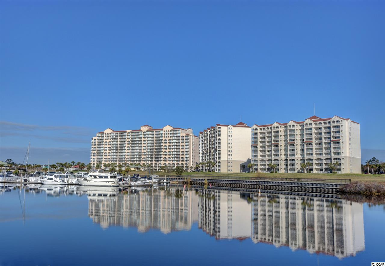 If you Love Waterway Living, this Beautifully furnished,3 bedrooms 3-bathroom condo at Yacht Club Villas in Barefoot Resort is A MUST SEE! Located on the 5th floor with spectacular views of the Waterway, Marina, and SC's largest outdoor pool. This unit can be used as a 3 bedroom or has the flexibility to be divided into 3 individual rental units due to it being set up as lockout units. This condo offers an amazing open concept with a wonderful kitchen featuring granite counter tops . Two of the bathrooms have a separate tub and shower with large vanity areas. Enjoy your views from either of the two incredible balconies. This is Coastal Living at its very best with Luxurious Amenities in the North Myrtle Beach area. Owners are allowed pets. Bring your golf clubs and enjoy a round of golf at one of our 4 top rated golf courses designed by Greg Norman, Davis Love, Pete Dye and Tom Fazio. You are just minutes from The BEST shopping, dining, and entertainment along the Grand Strand. This will be a perfect investment property, second home, or primary residence. Schedule an Appointment to View Today!