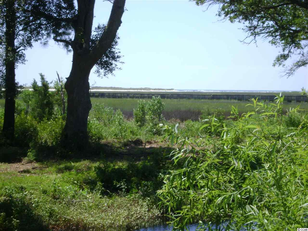 Beautiful inlet creek view with views that extend to the ocean.  What a great lot to build your dream home on, and have fantastic sunrise views.