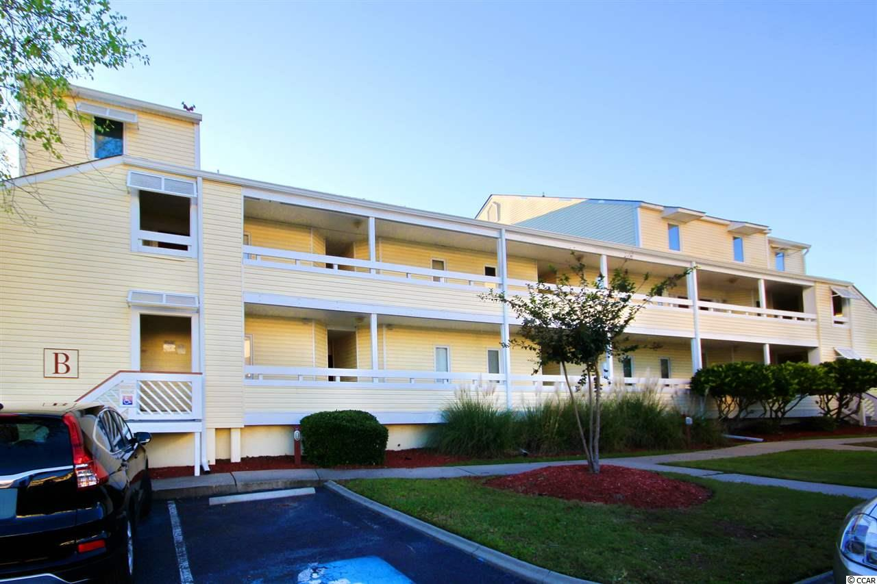 """Spacious 2-bedroom, 2.5-bathroom condo on the second floor in the highly sought after """"B"""" building of North Myrtle Beach Golf & Tennis community at Possum Trot Golf Course. Building B is located steps away from Possum Trot Golf Course as well as the J Bryan Floyd Recreation Center & Central Park, which offers baseball fields, basketball courts and much more. This property has been lovingly cared for by the owners and never rented. The main level includes your kitchen appointed with white cabinetry and new stainless steel range and new dishwasher. Directly beyond the kitchen you enter an expansive great room that leads to a screened-in deck overlooking the tennis courts with views of the Possum Trot driving range. The main level also includes a powder/laundry room and very large storage closet. The upper level boasts two very generously sized bedrooms and two bathrooms. A private deck off of the master bedroom provides a peaceful spot to enjoy yet more views of the tennis courts and driving range. North Myrtle Beach Golf & Tennis offers many amenities including an outdoor swimming pool and several tennis courts. All this, just a short golf cart ride to the Atlantic Ocean!"""