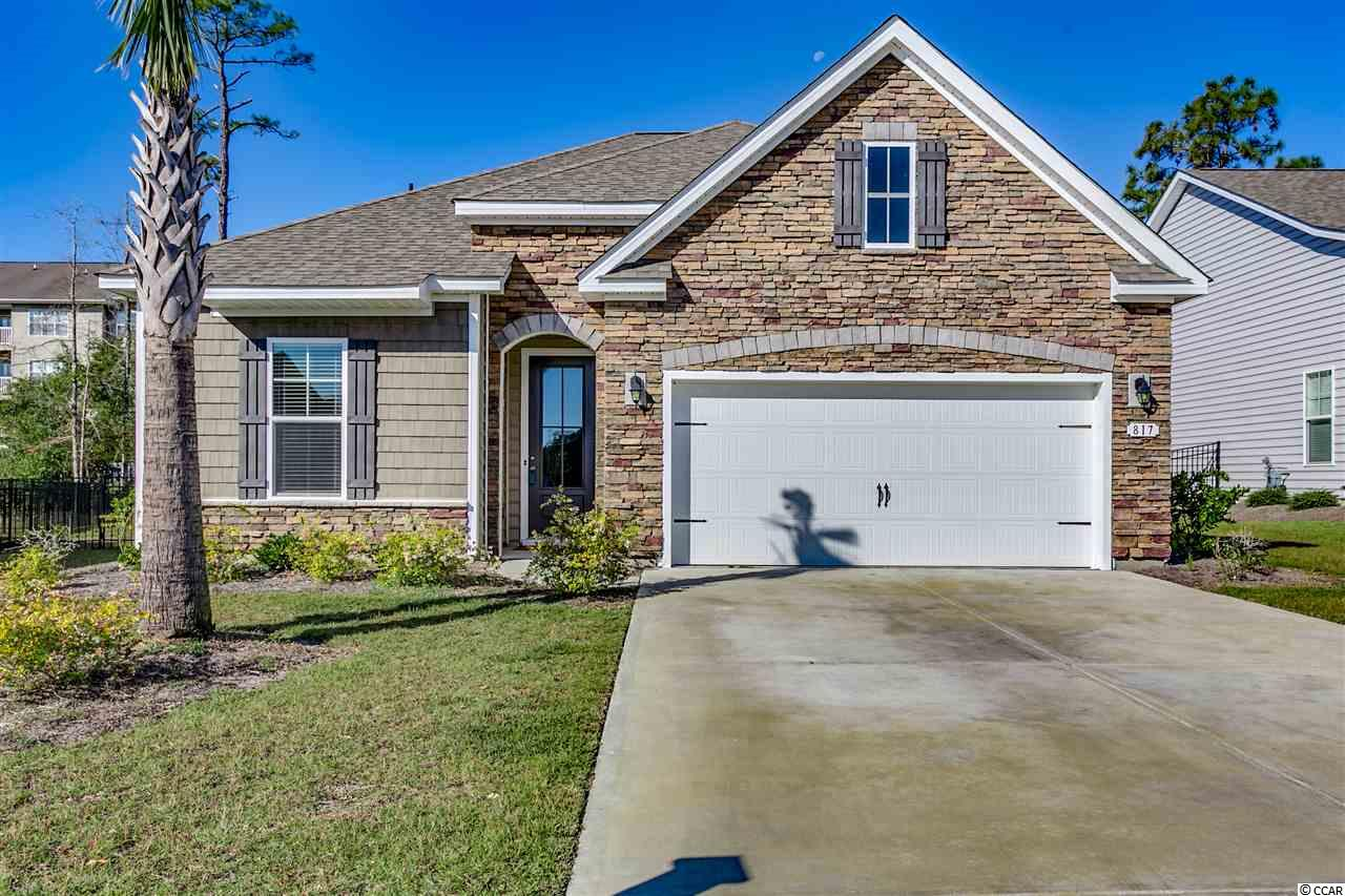 This fantastic 3br/2ba home located in the desirable Belle Park section of North Myrtle Beach is only 1.5 years old and ready for a new owner. From the second you walk through the front door of this well appointed home, you are greeted with an open floor plan and quality upgrades. Tile floors run throughout the entire home with the exception of the bedrooms to give you a cozy feel. The upgraded kitchen features granite counters, stainless steel appliances, tons of cabinet and counter space, backsplash, and a large pantry. Enjoy eating at your breakfast bar or in the large dining area just off of the kitchen. The large living room allows plenty of room for the entire family to spread out. The master bedroom boasts a tons of space, large walk-in closet, double sinks, large garden tub, and a spacious tiled walk-in shower. The current owner fenced in the spacious back yard allowing room for you and your family to enjoy beautiful Carolina evenings. If you are someone who enjoys being outside, sit on your covered rear porch with plenty of room to grill or just relax. If you are someone who enjoys the beach, you are just a short ride or golf cart ride to some of North Myrtle Beach's best beach locations, and you are just a short five minute ride to the famous Main Street area of North Myrtle Beach where they shut down the street and play beach music in the summers. Location is everything when buying a home, and if you want to be close to everything in a newer home, have all the upgrades you could want, this home is it. If you are looking for the perfect place to call home here at the beach, make sure you put 817 Bronwyn Circle on your list of must see homes!