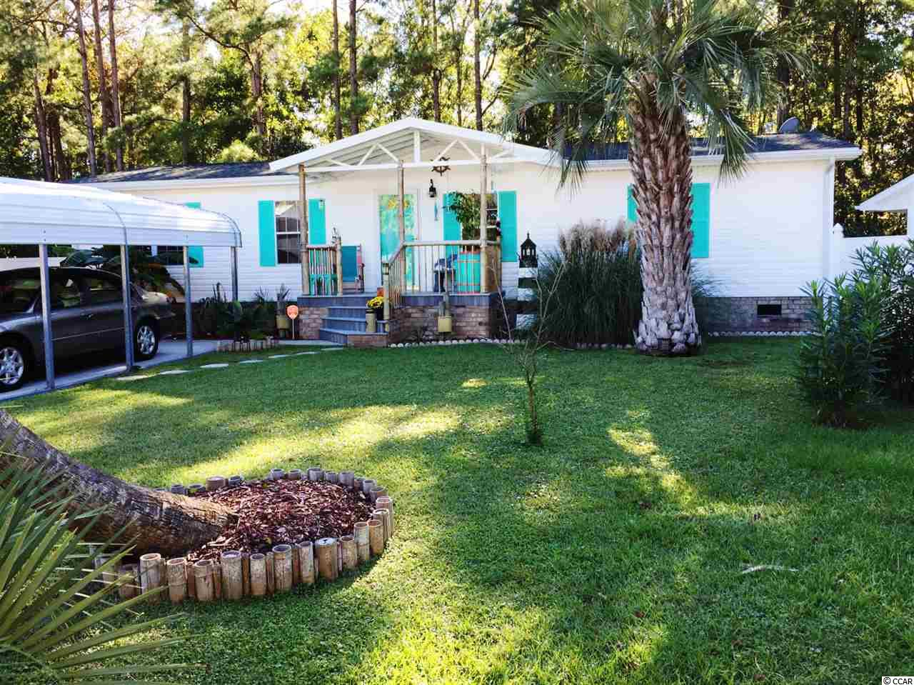 Easy to show, hidden gem close to beach. This place has pure coastal feel including a 26 x 12 screen porch with hot tub. Roof is 2 years old, kitchen is 4 years old, golf cart garage/workshop . 3/4 inch drywall throughout. Super Low HOA! Call for your showing appointment soon! We are in multiple offers! Please submit your highest and best by 3:00 PM on January 25, 2019.